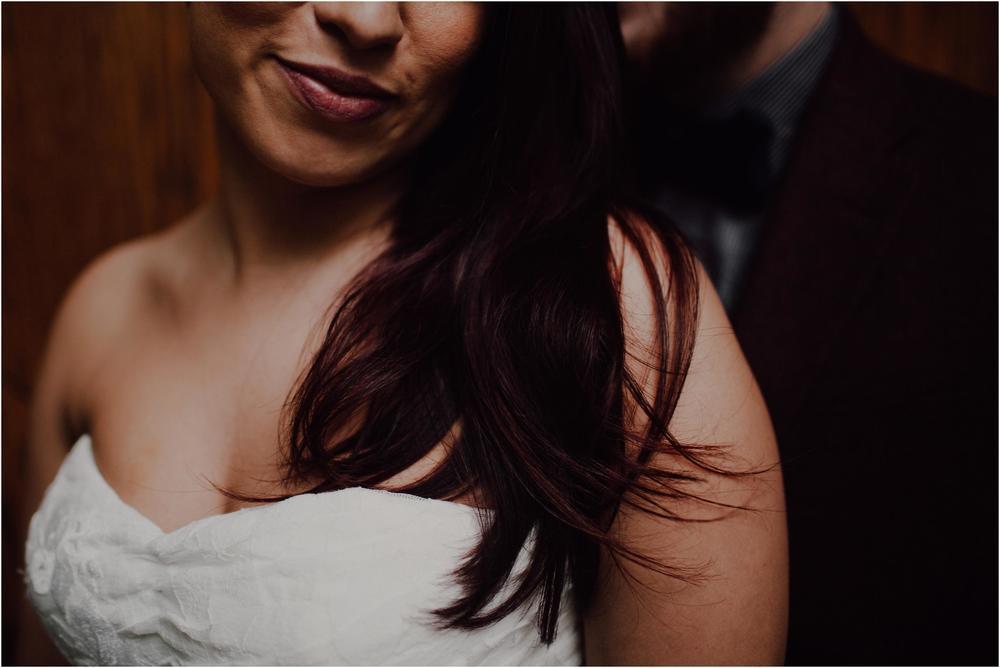 bride smiling over shoulder at groom