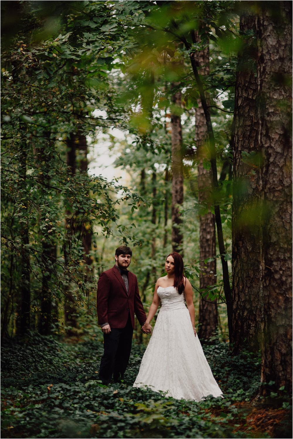 bride and groom in middle of the forest