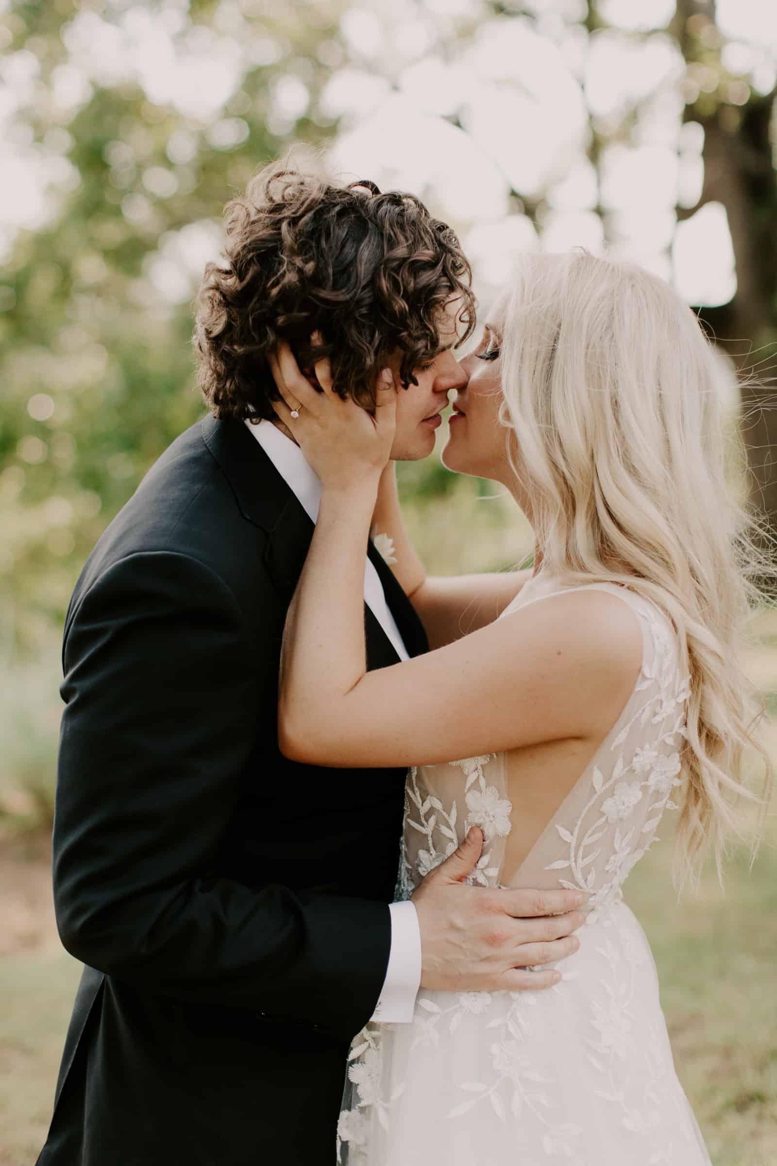 arkansas wedding photographer videographer couple kissing fayetteville