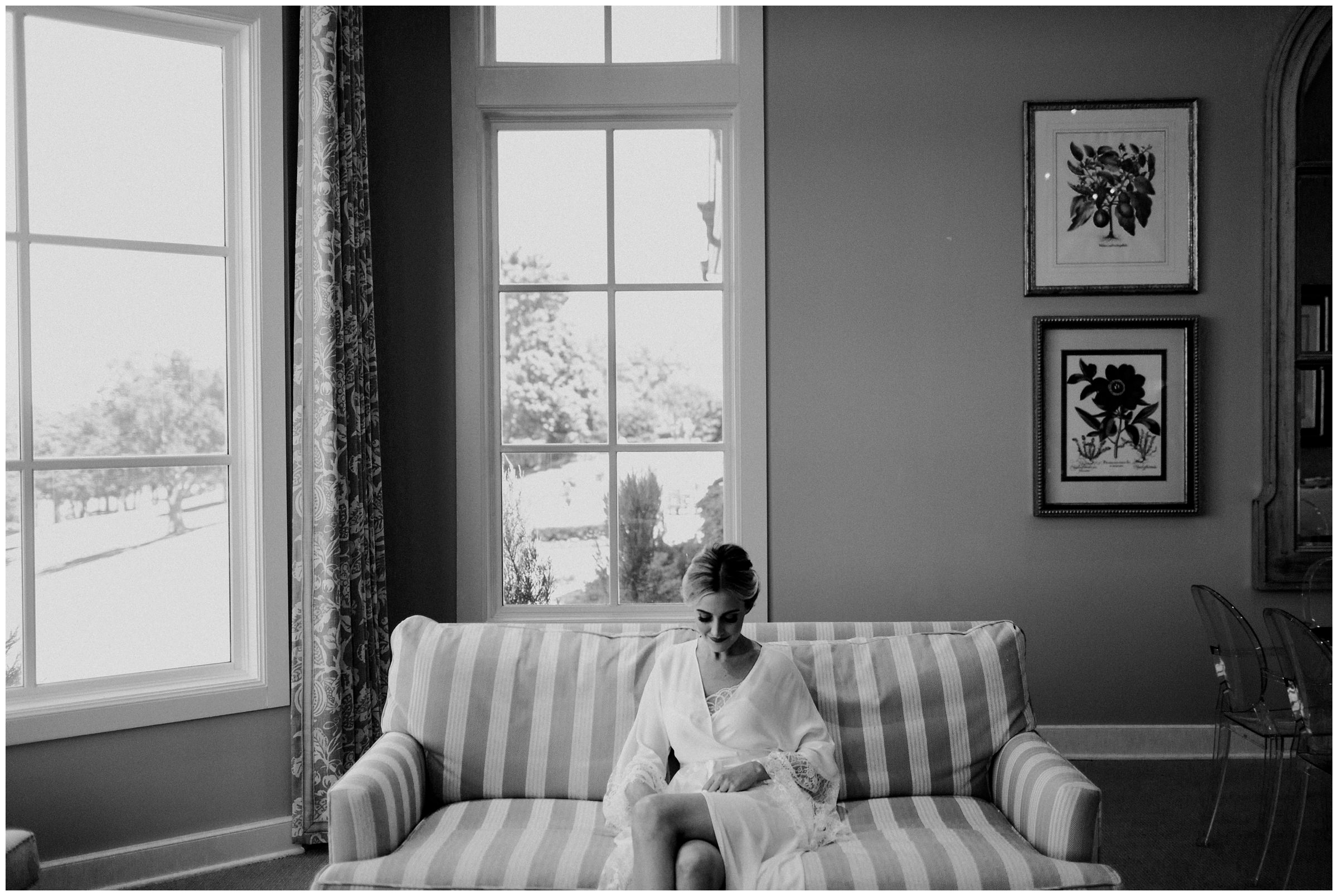 bride sitting on couch at southern hills country club