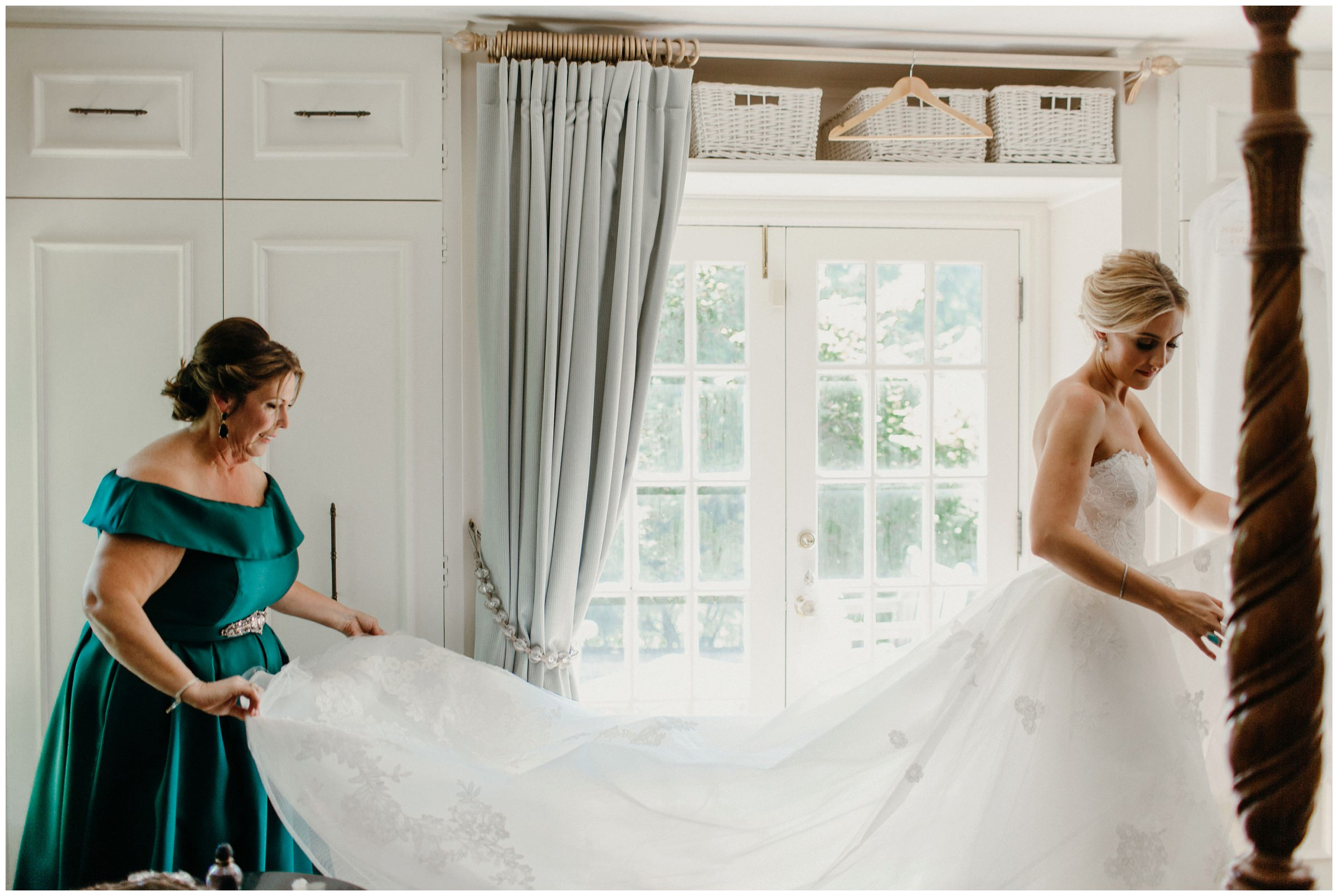 mother helping bride put on her dress in tulsa oklahoma
