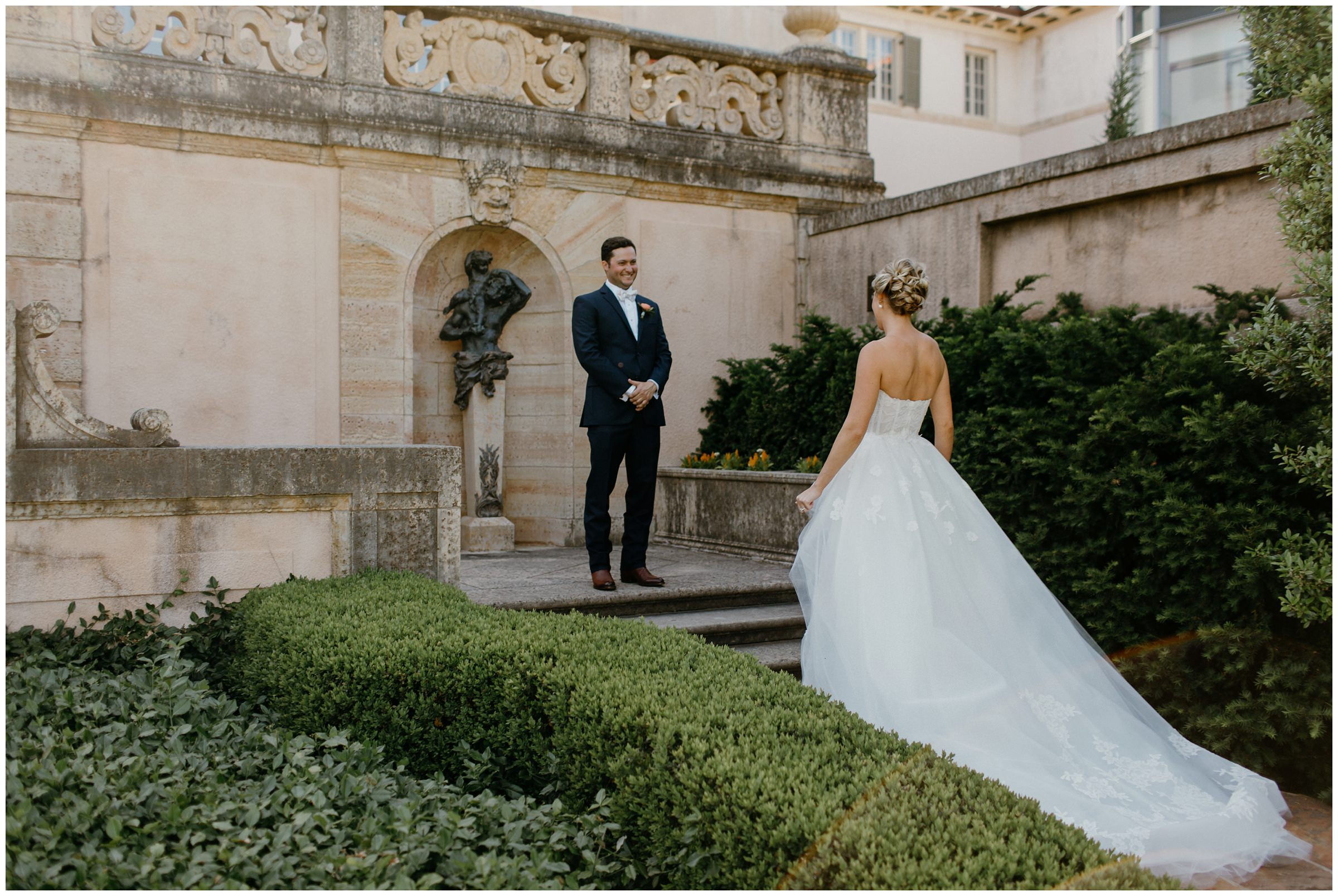 groom sees bride for first time at philbrook museum wedding