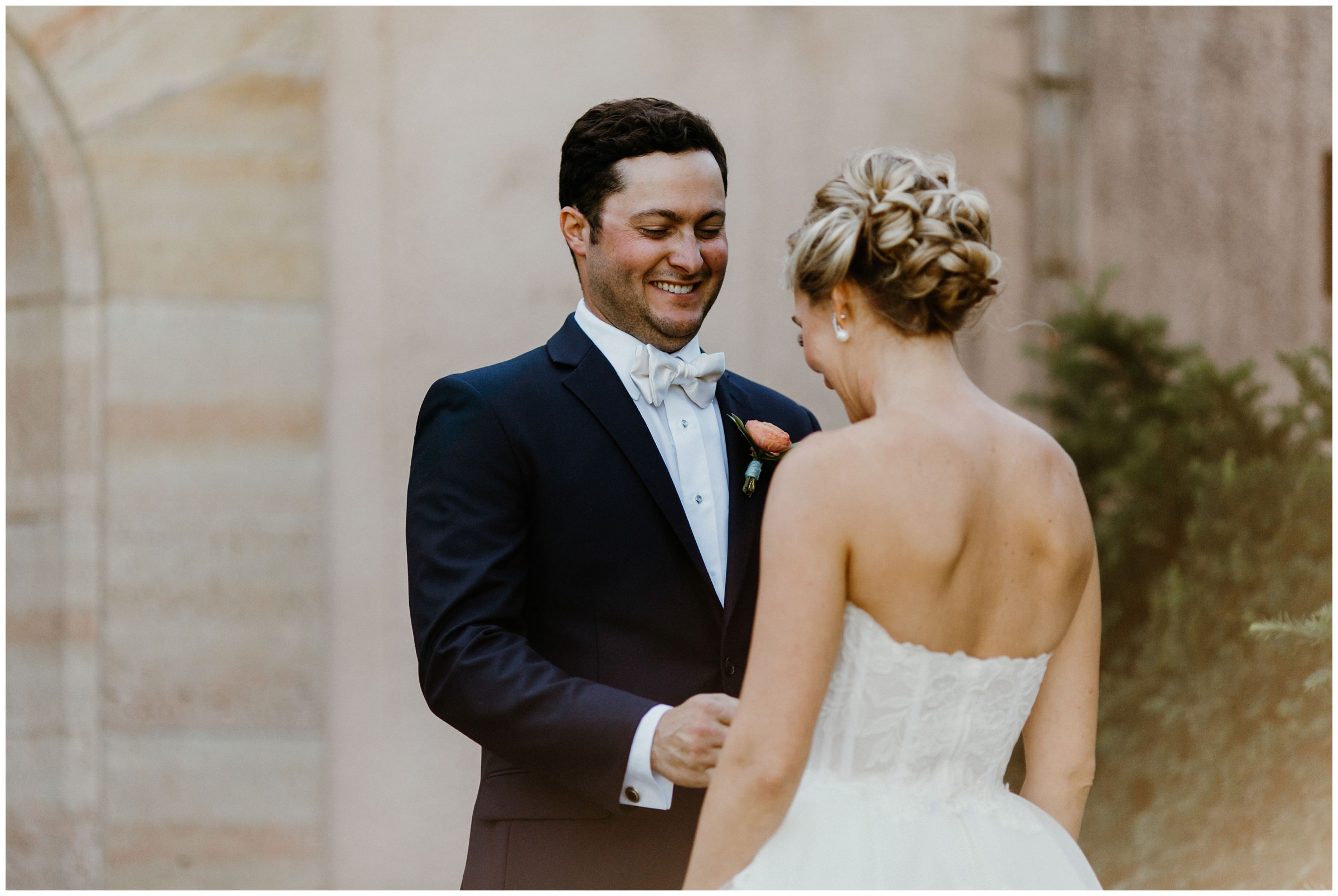 groom smiles at bride philbrook museum