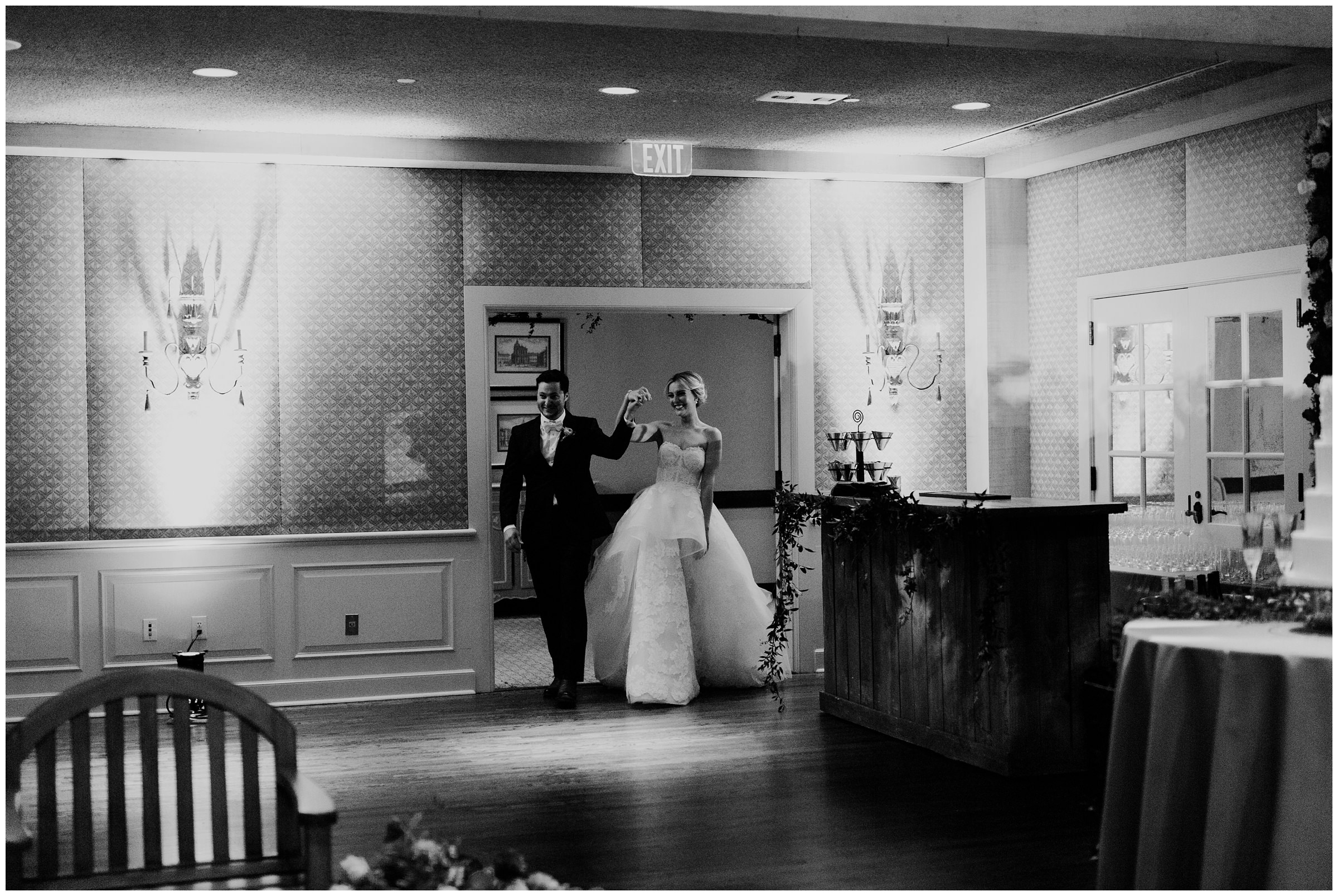couples grand entrance at southern hills country club wedding