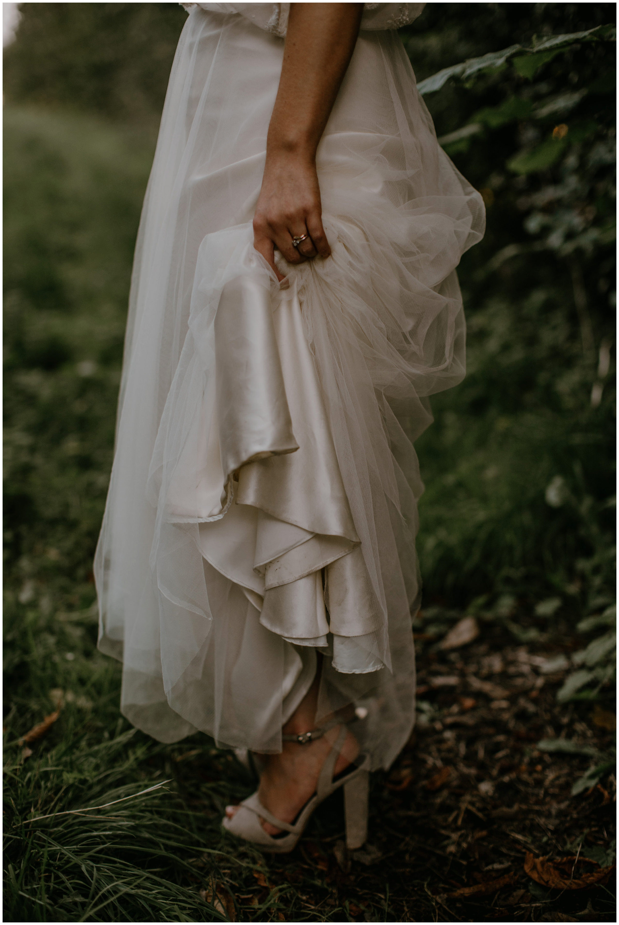 bride holding dress up