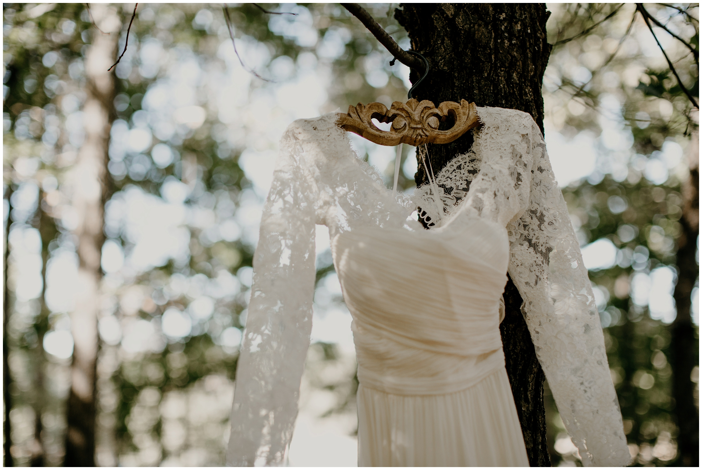 wedding dress hanging on wooden bhldn hanger