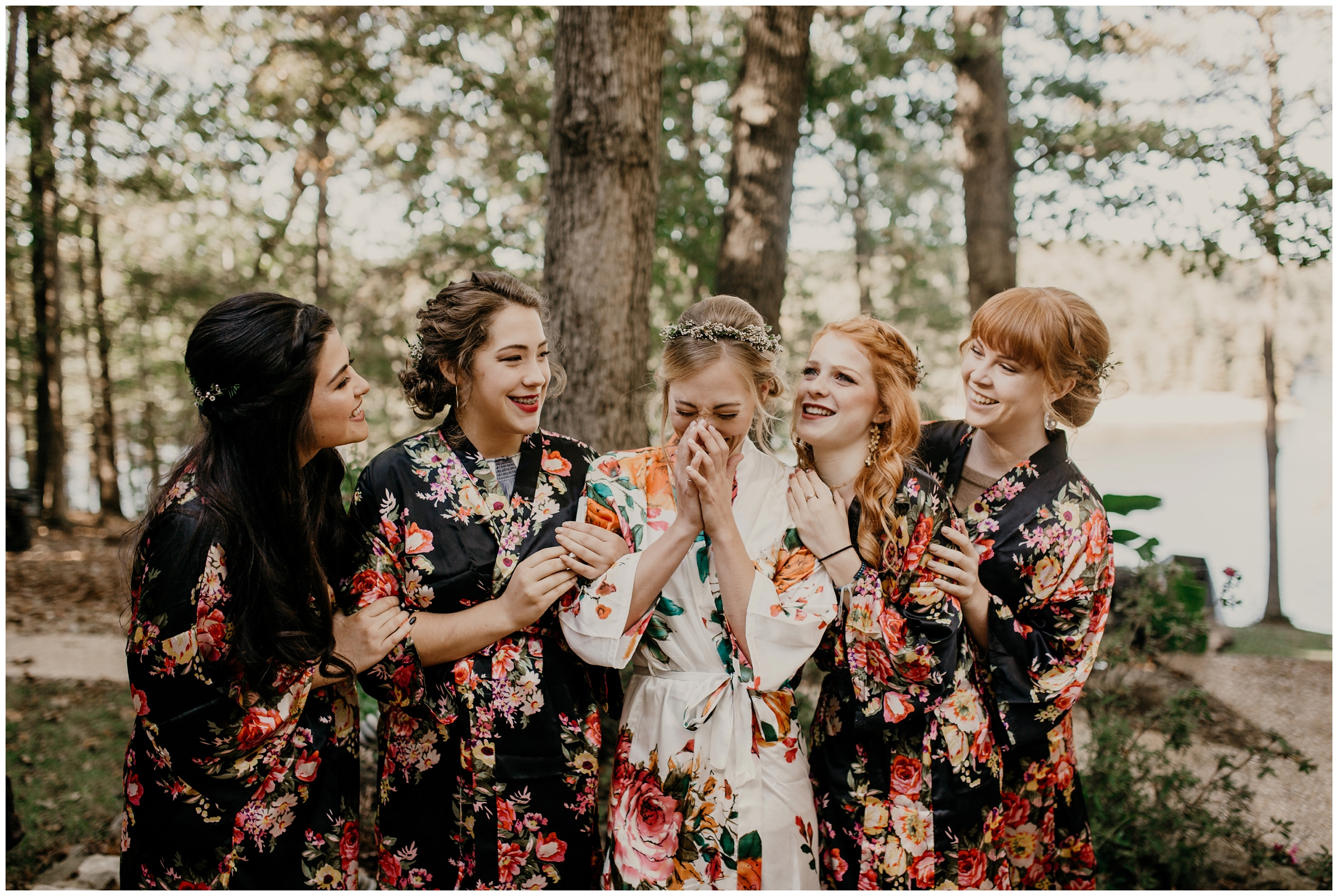 bridesmaids in floral robes laughing