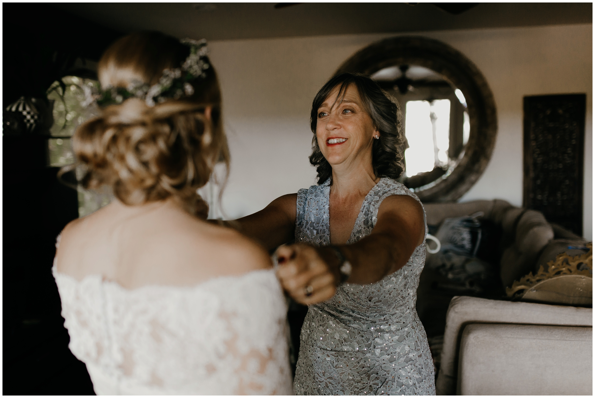 mother looking adoringly at her daughter at wedding