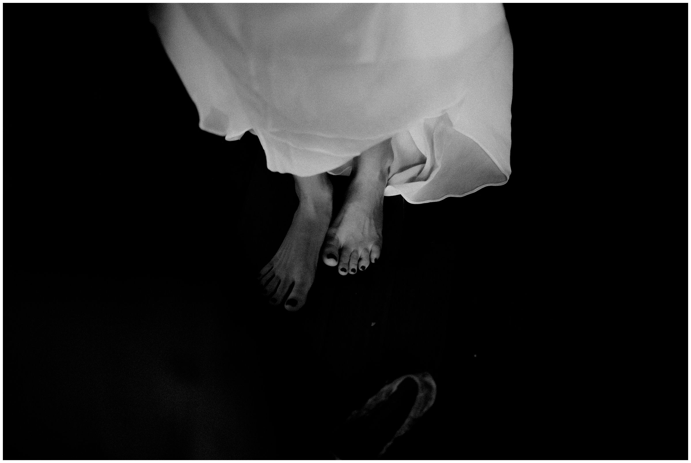 black and white photo of brides feet