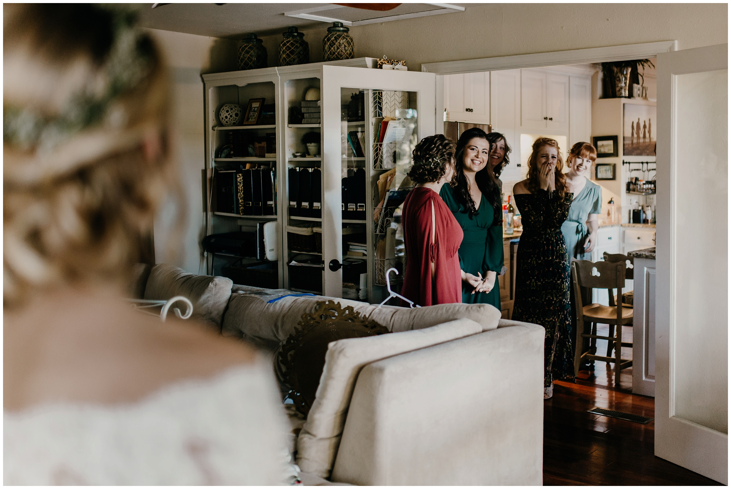 bridesmaids see bride in wedding dress for the first time