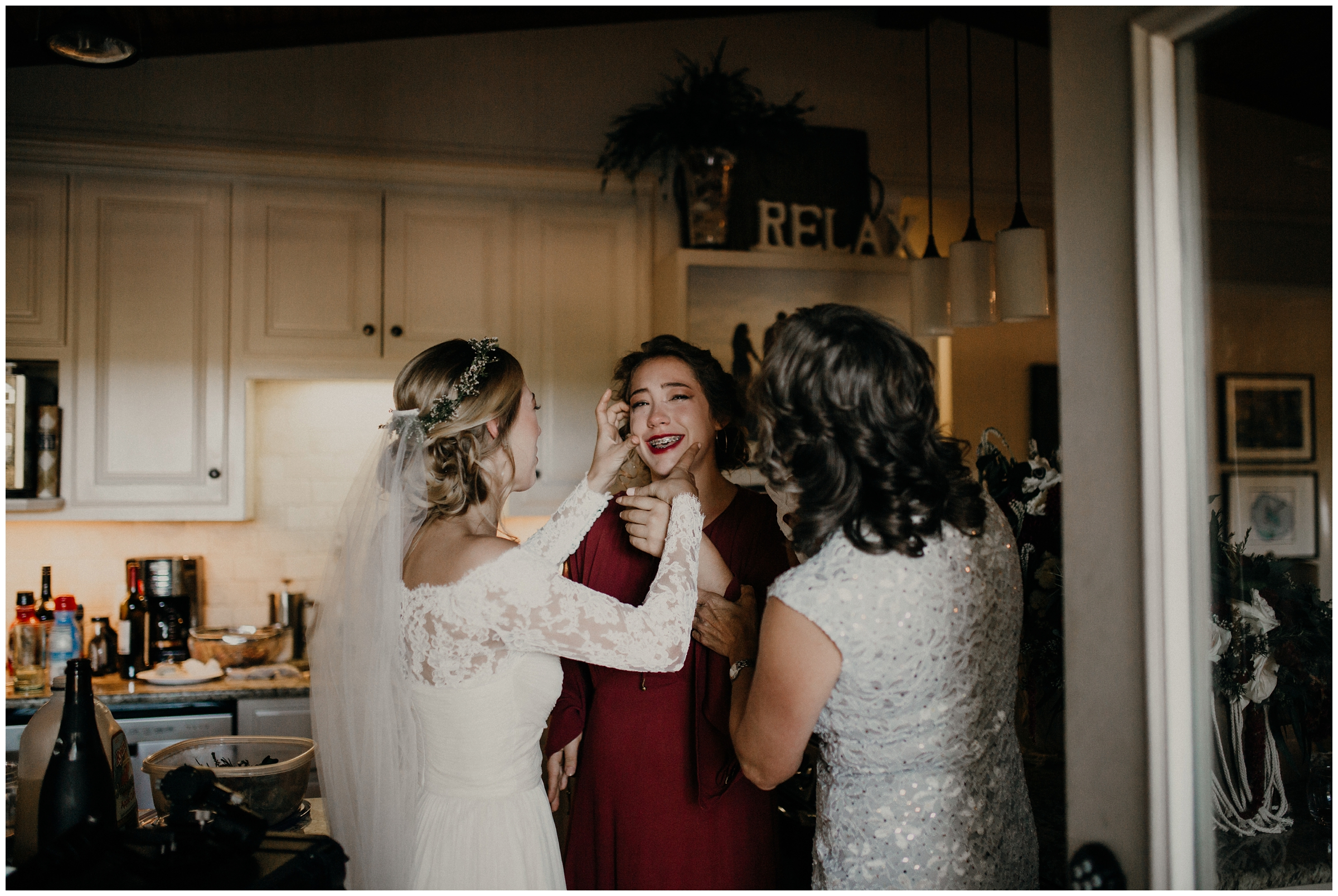bride, sister, and mother sharing an emotional moment