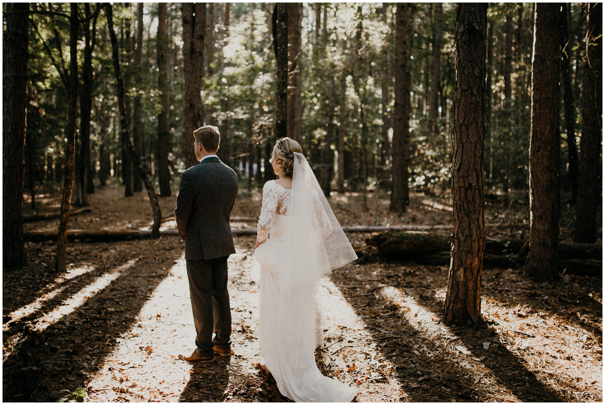 bride and groom having first look in forest arkansas wedding