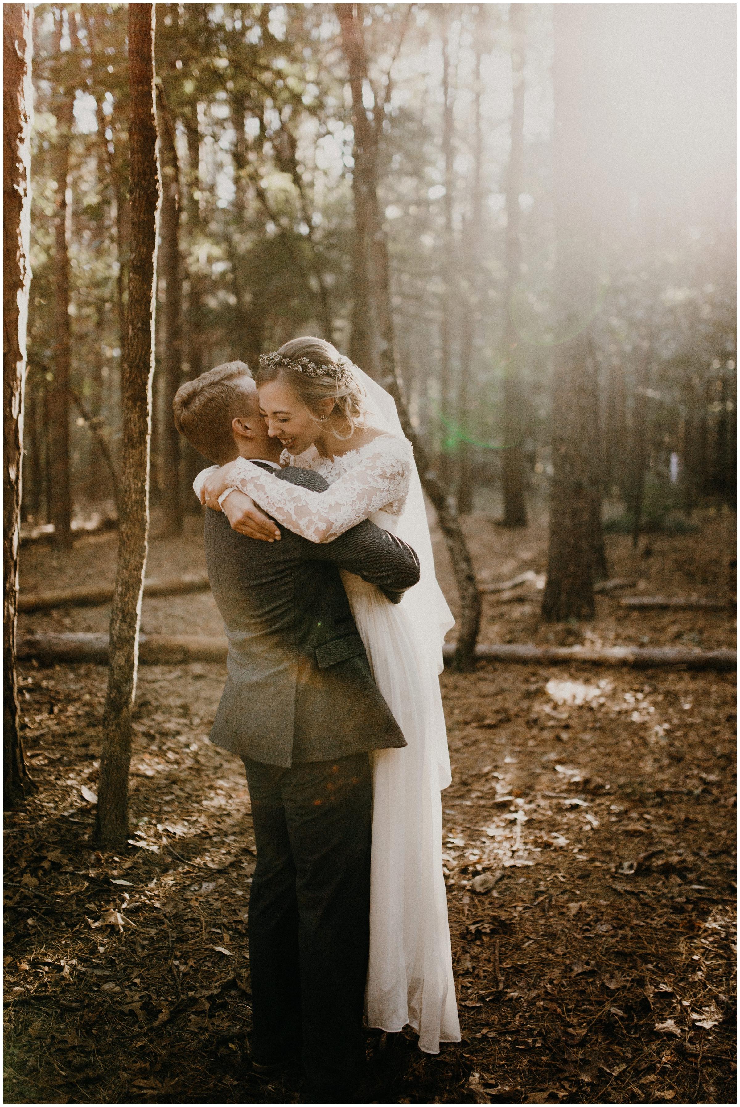 groom lifting up bride
