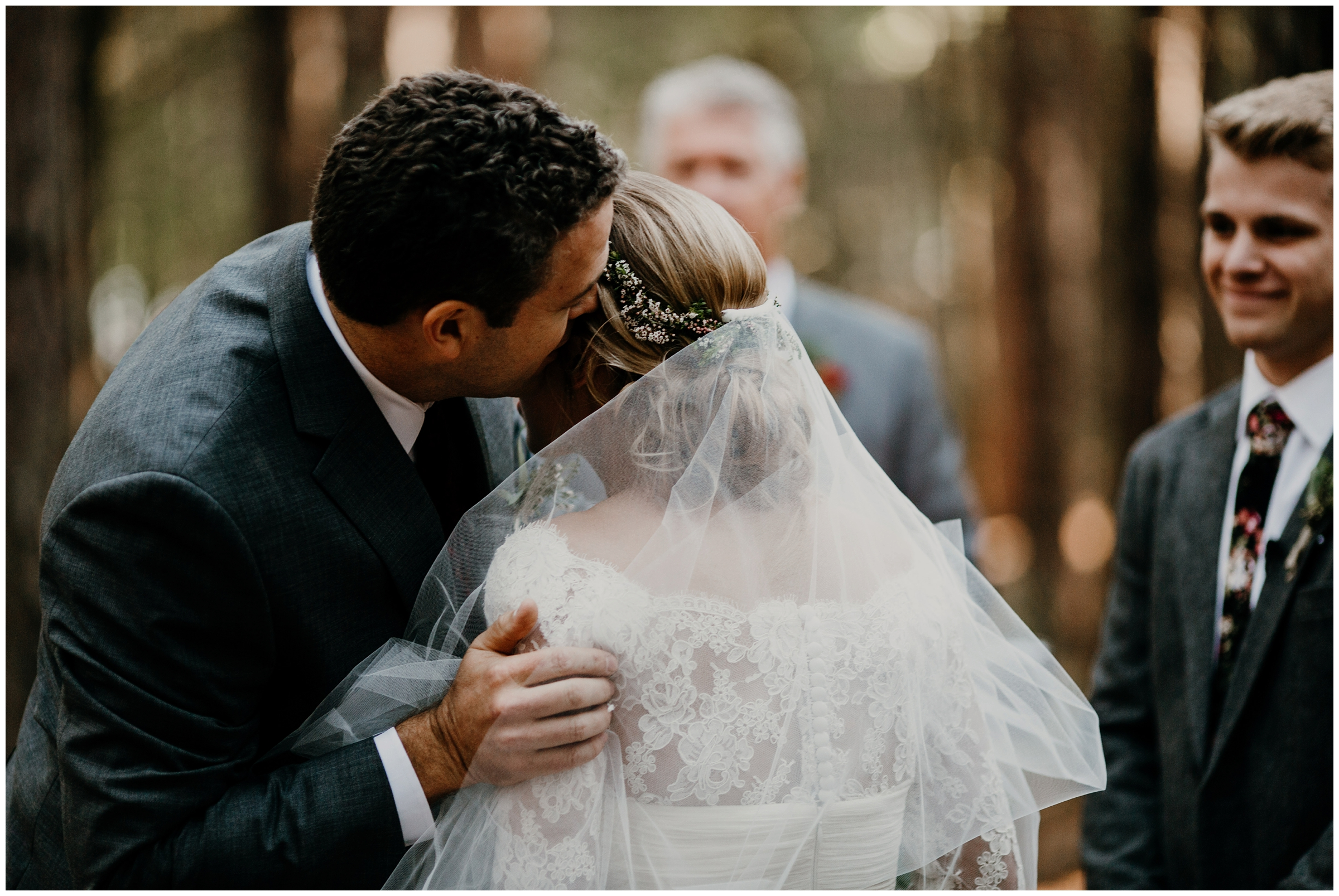 brides father kissing her