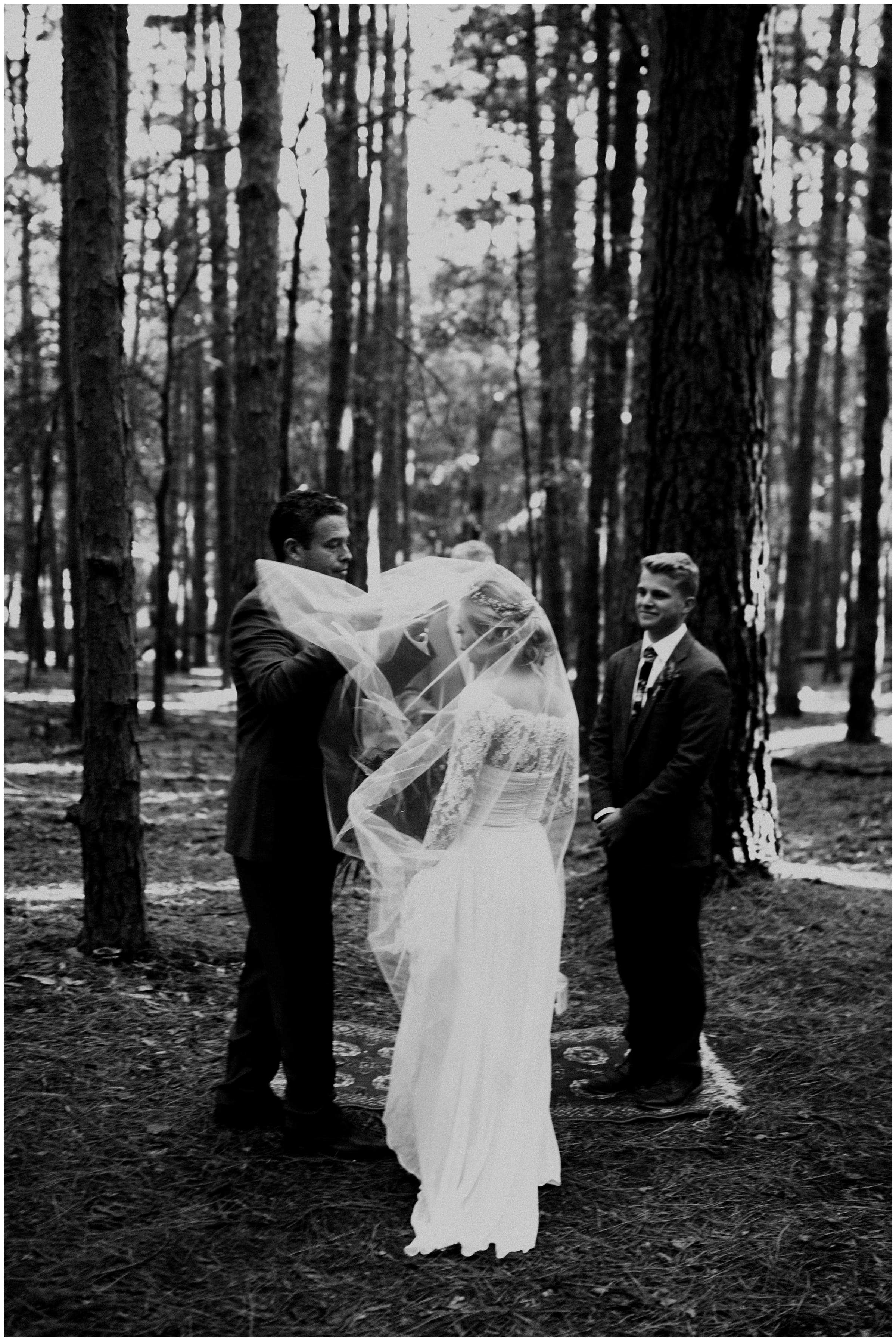 brides father lifts her veil at wedding