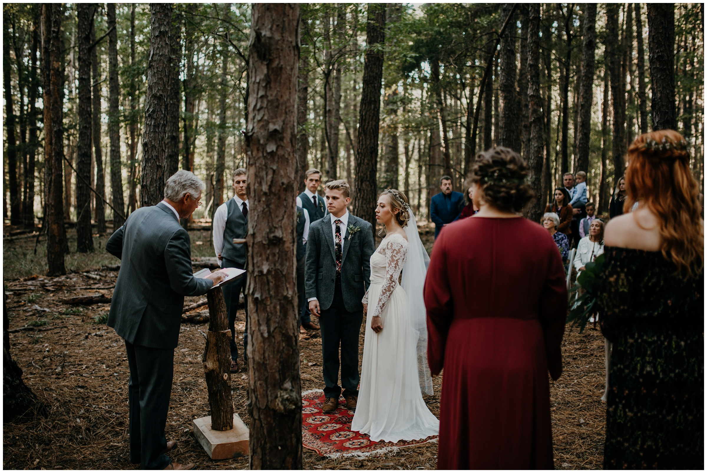 wedding ceremony on red turkish rug in forest boho