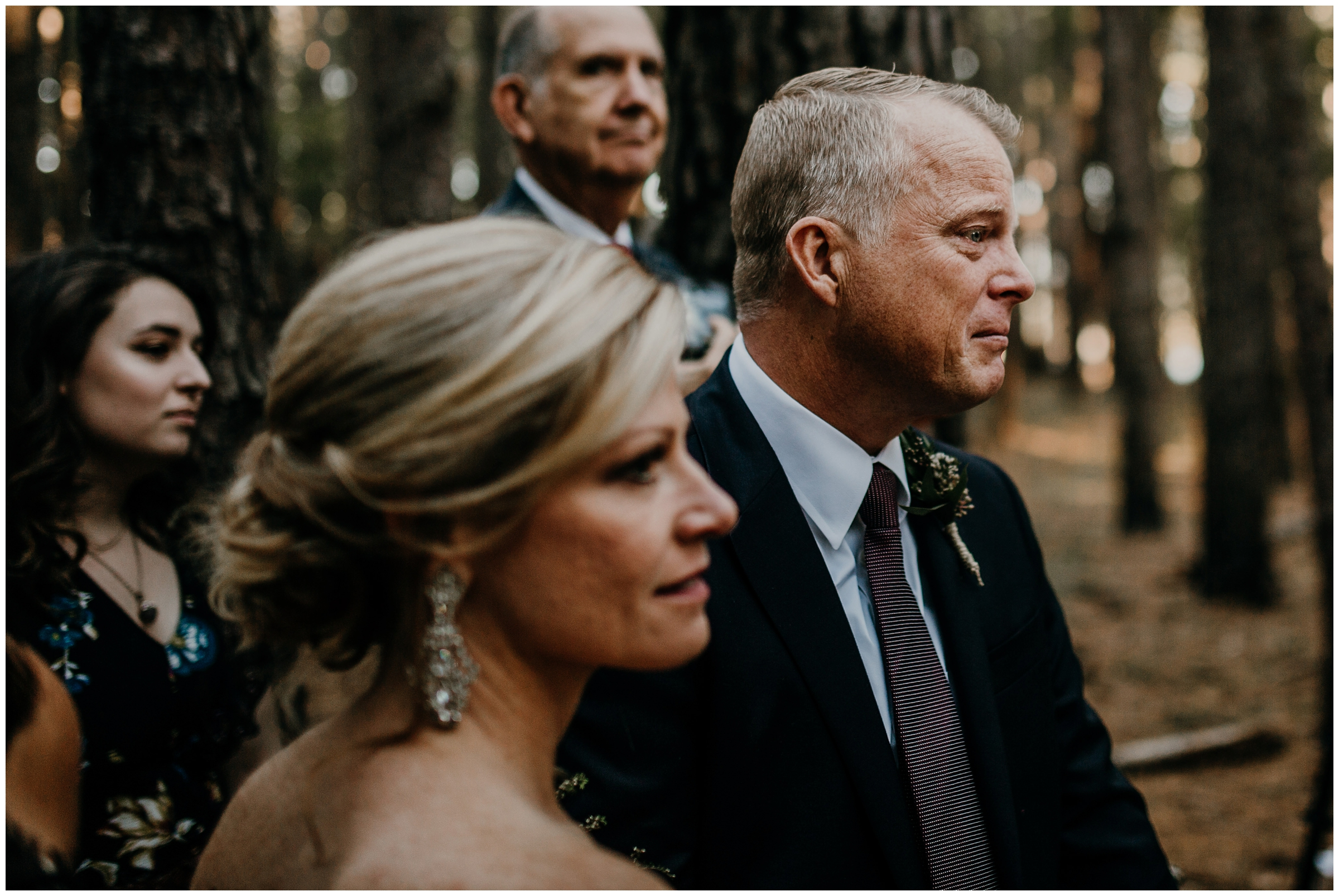 father of the groom crying during ceremony