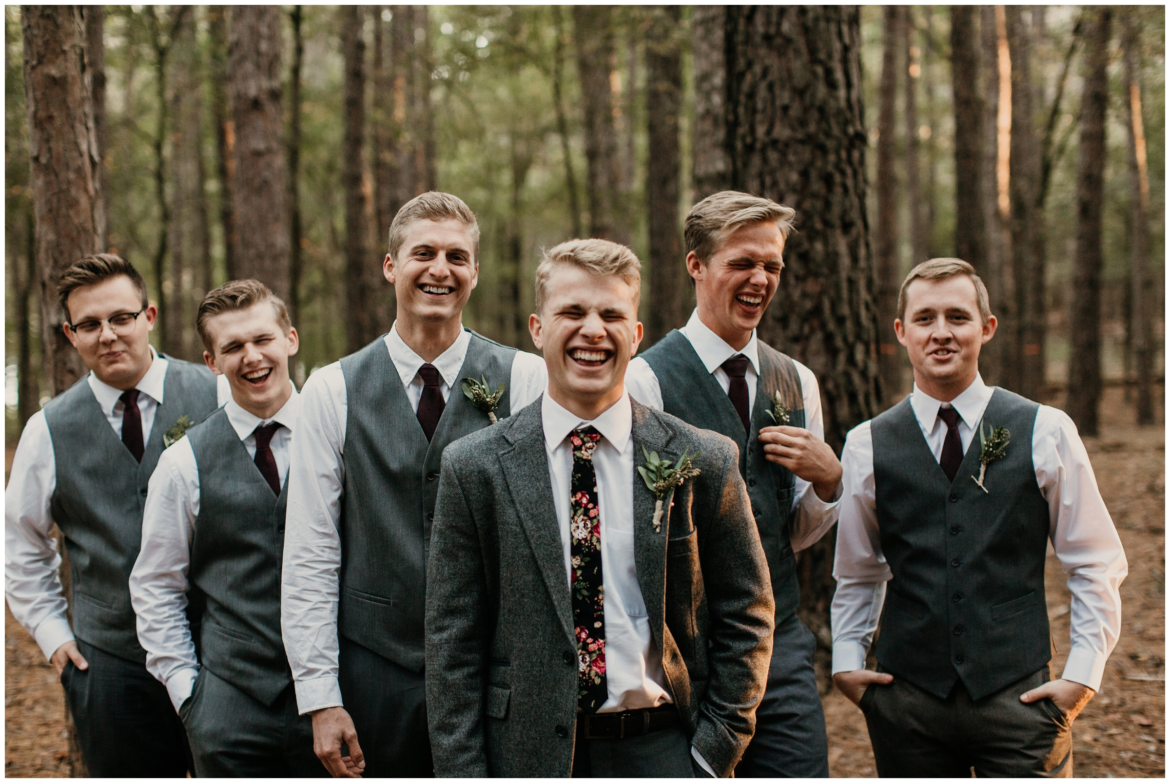 groom with floral tie boho arkansas wedding