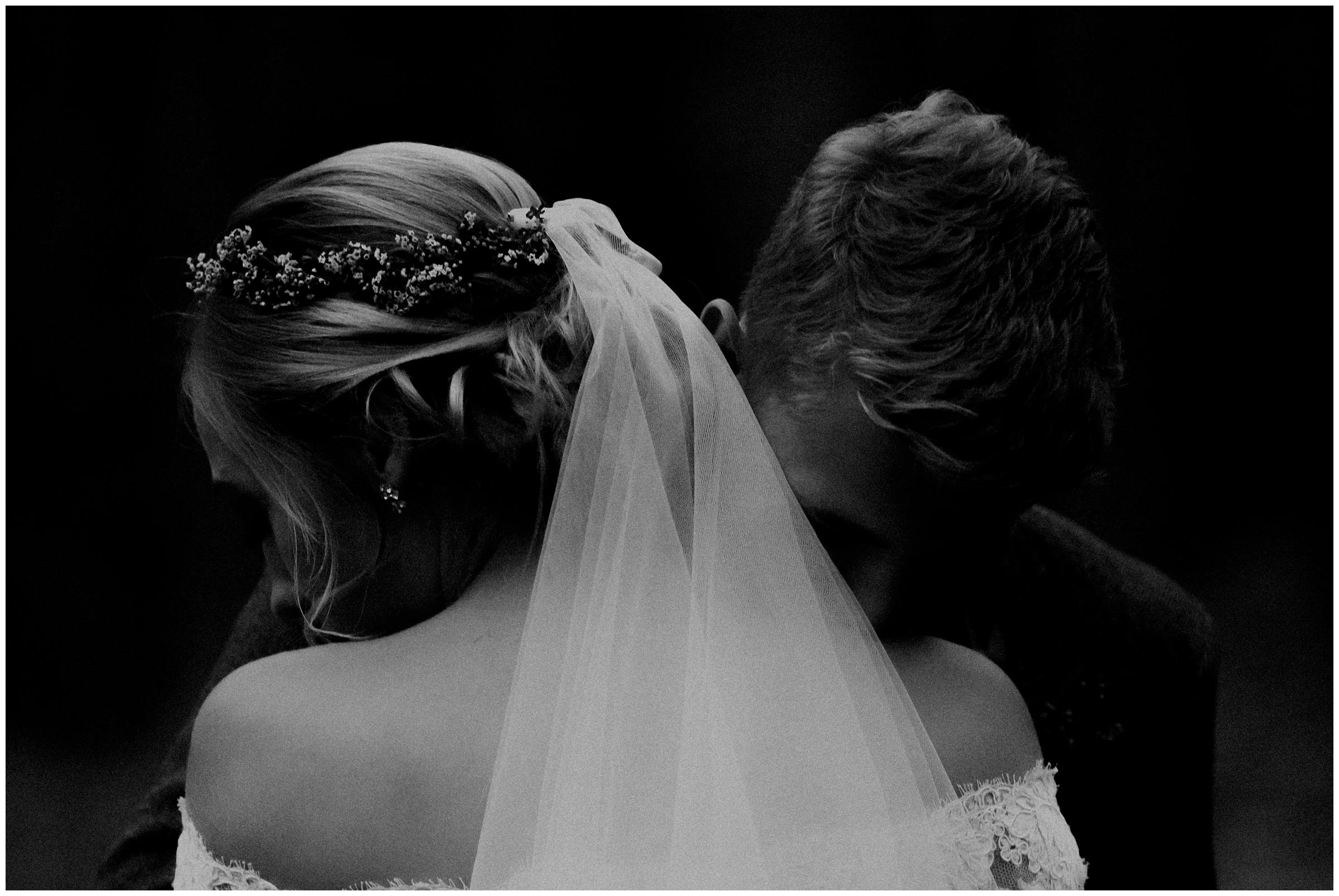 emotive photo of bride and groom