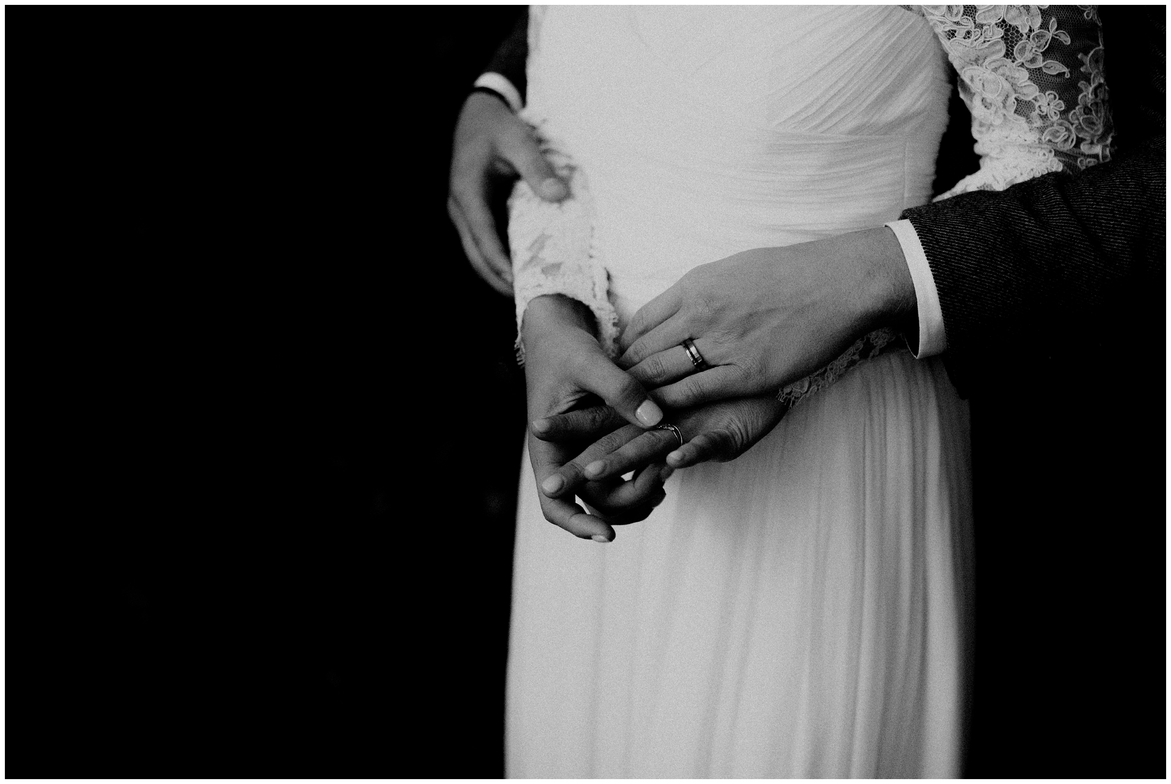 couple looking at wedding rings