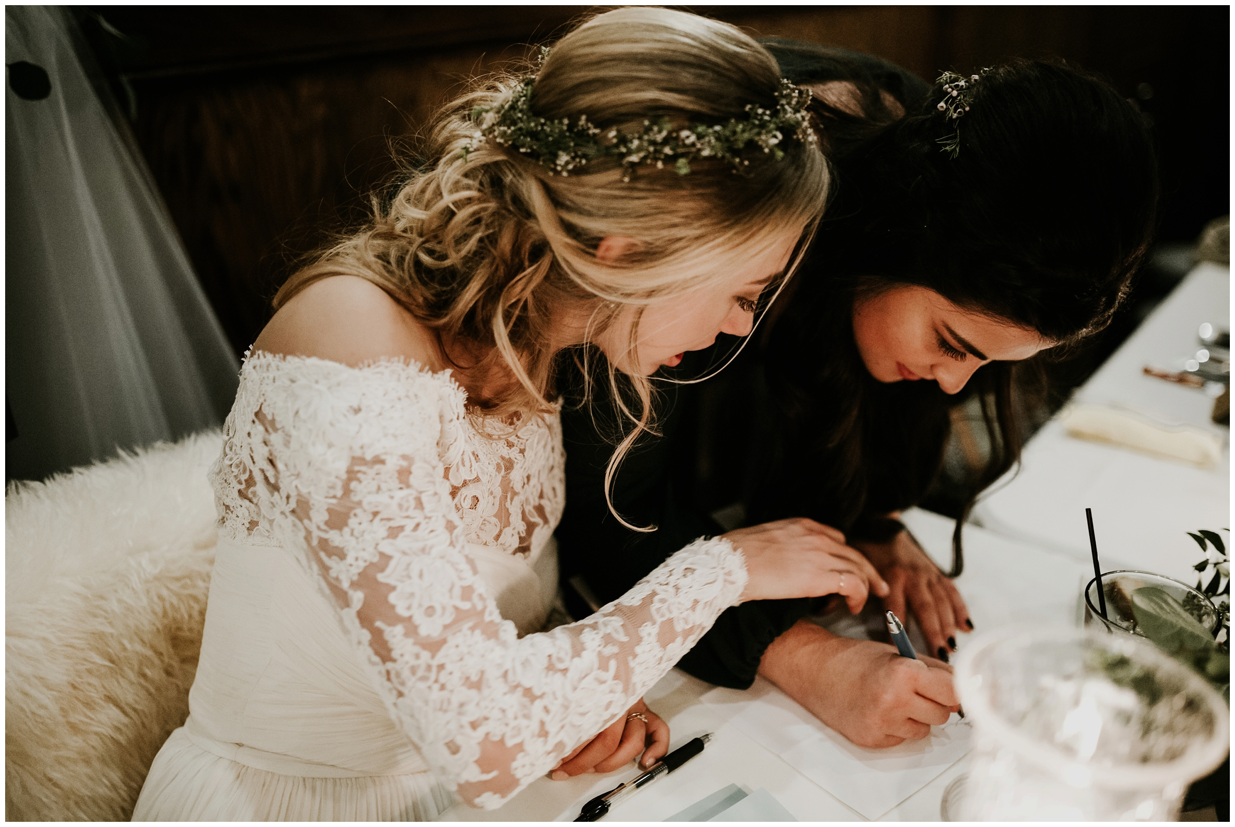 bridesmaid signing marriage certificate