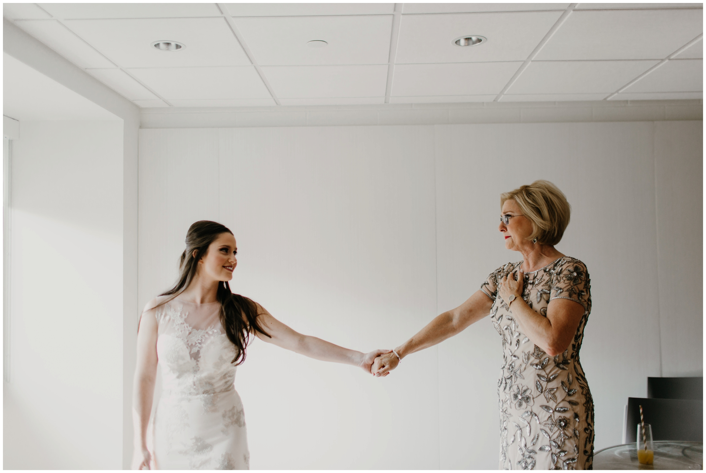 bride and daughter having a moment at fayetteville arkansas wedding