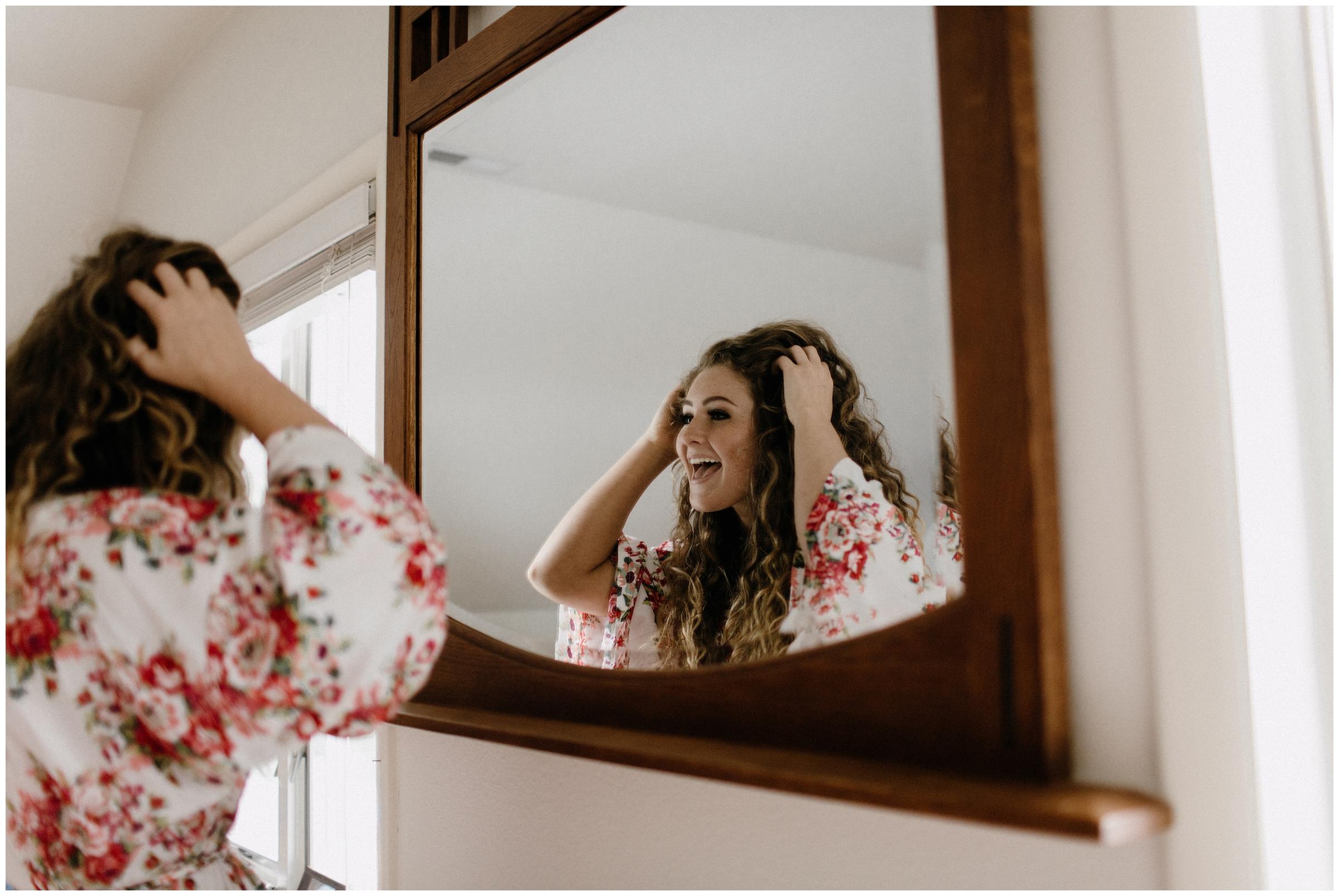 bride looking at herself
