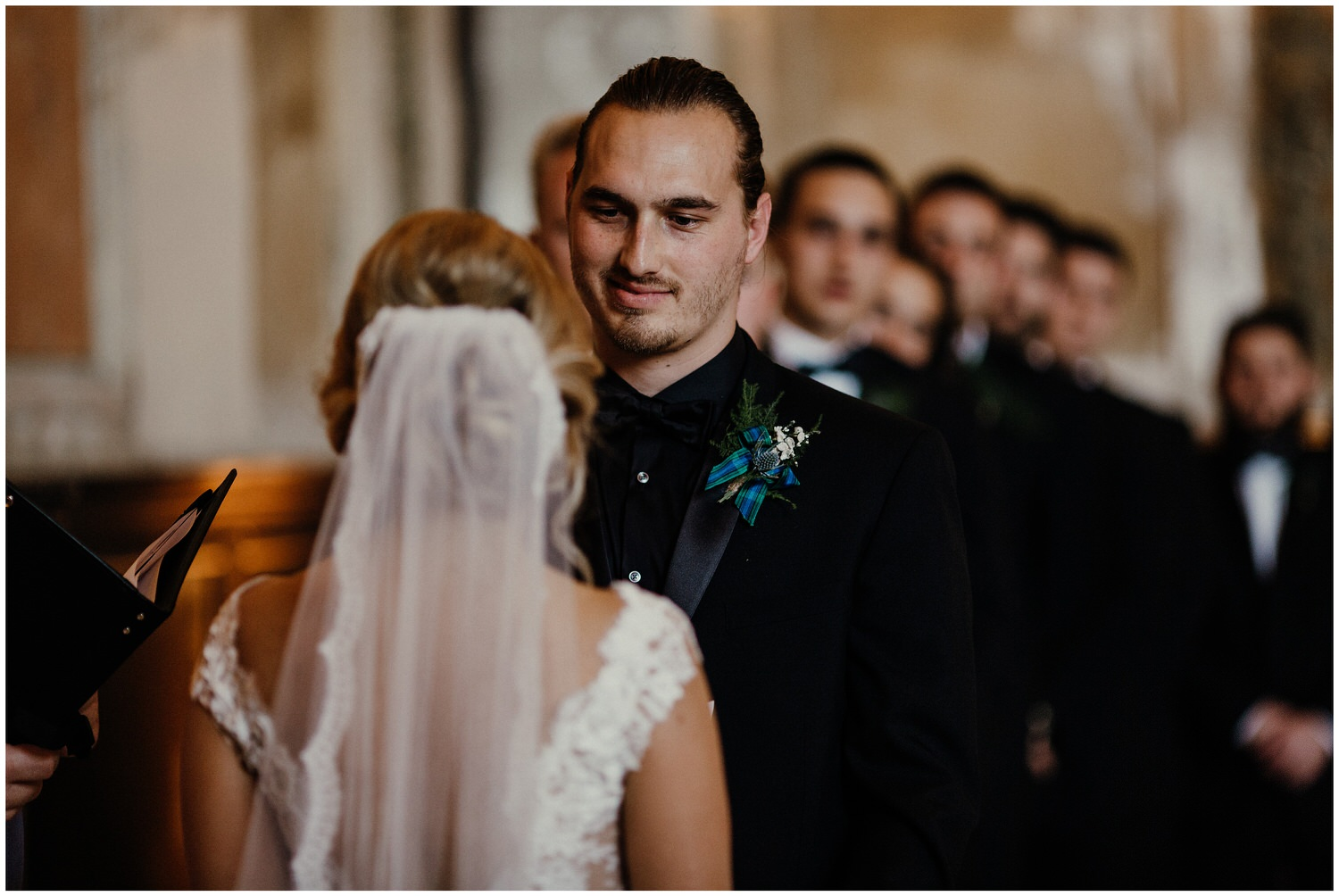 groom looking at bride during ceremony