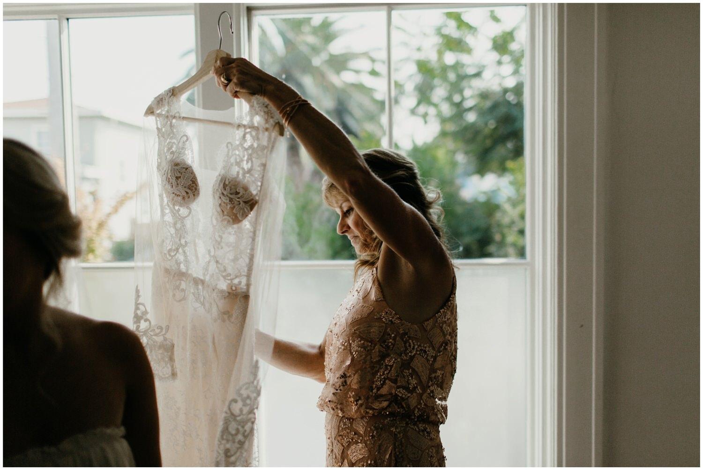 mother holding ines di santo wedding dress