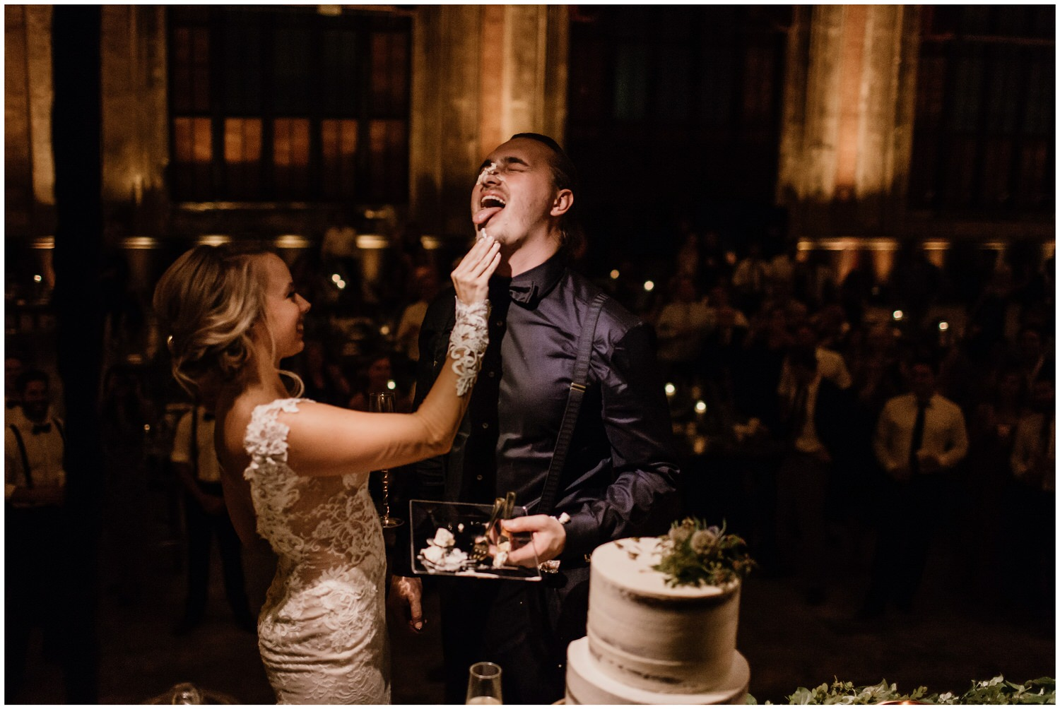 bride smashes cake in grooms face