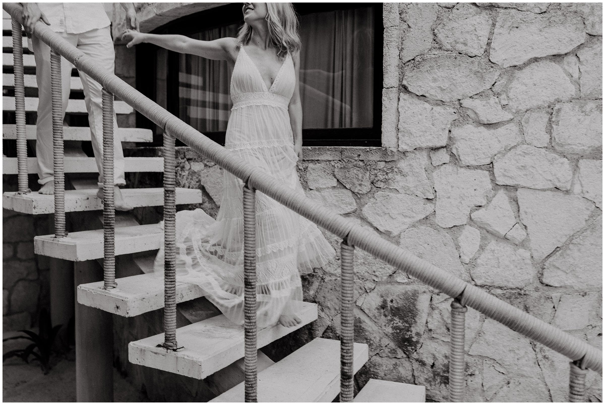 bride and groom walking down stairs at nest tulum