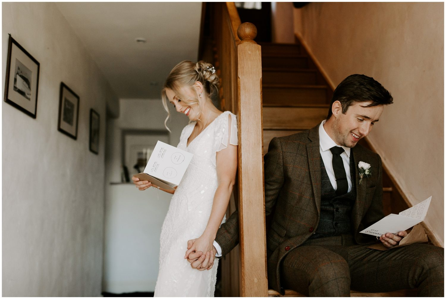 bride and groom reading letters on wedding day