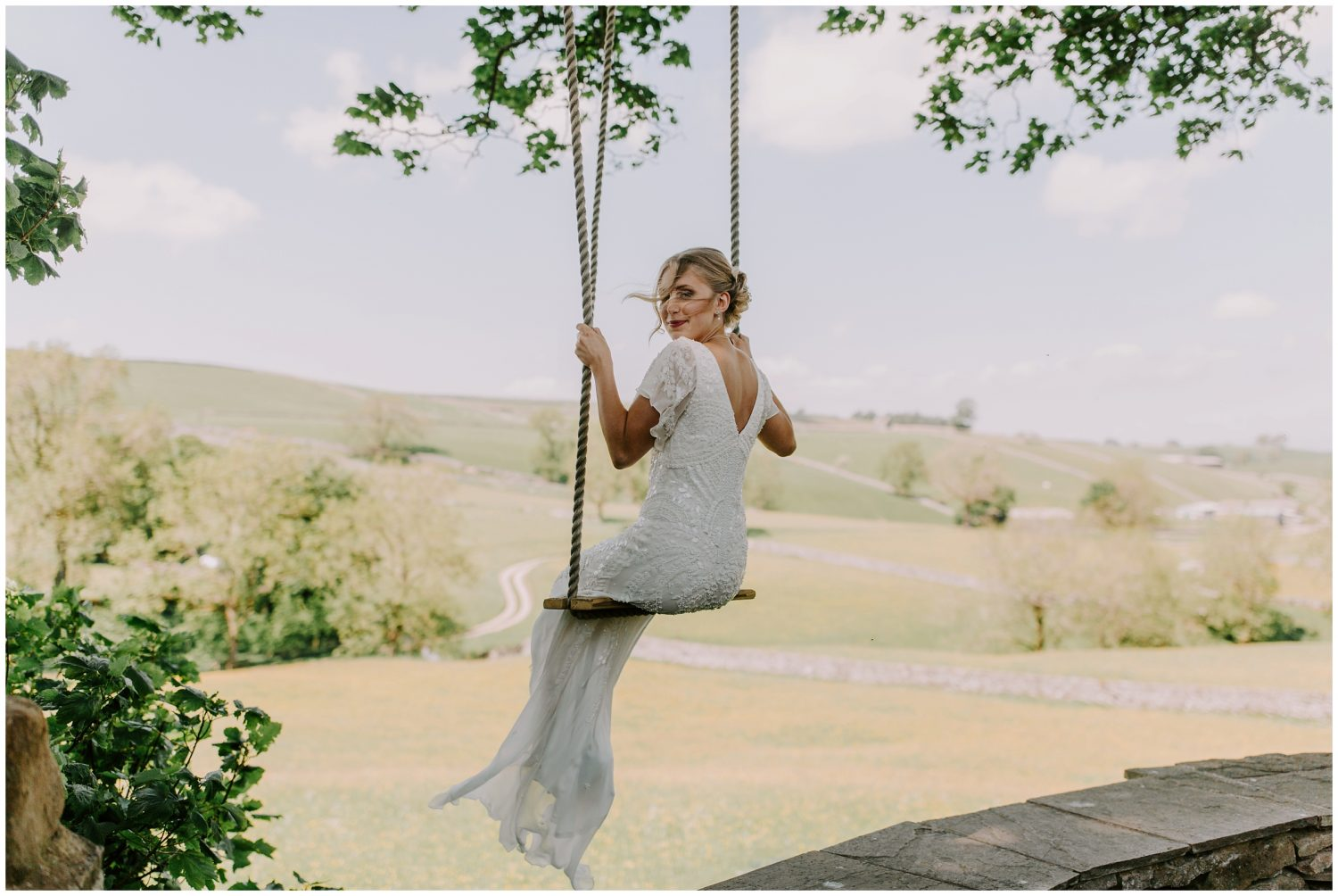 bride swinging on wedding day