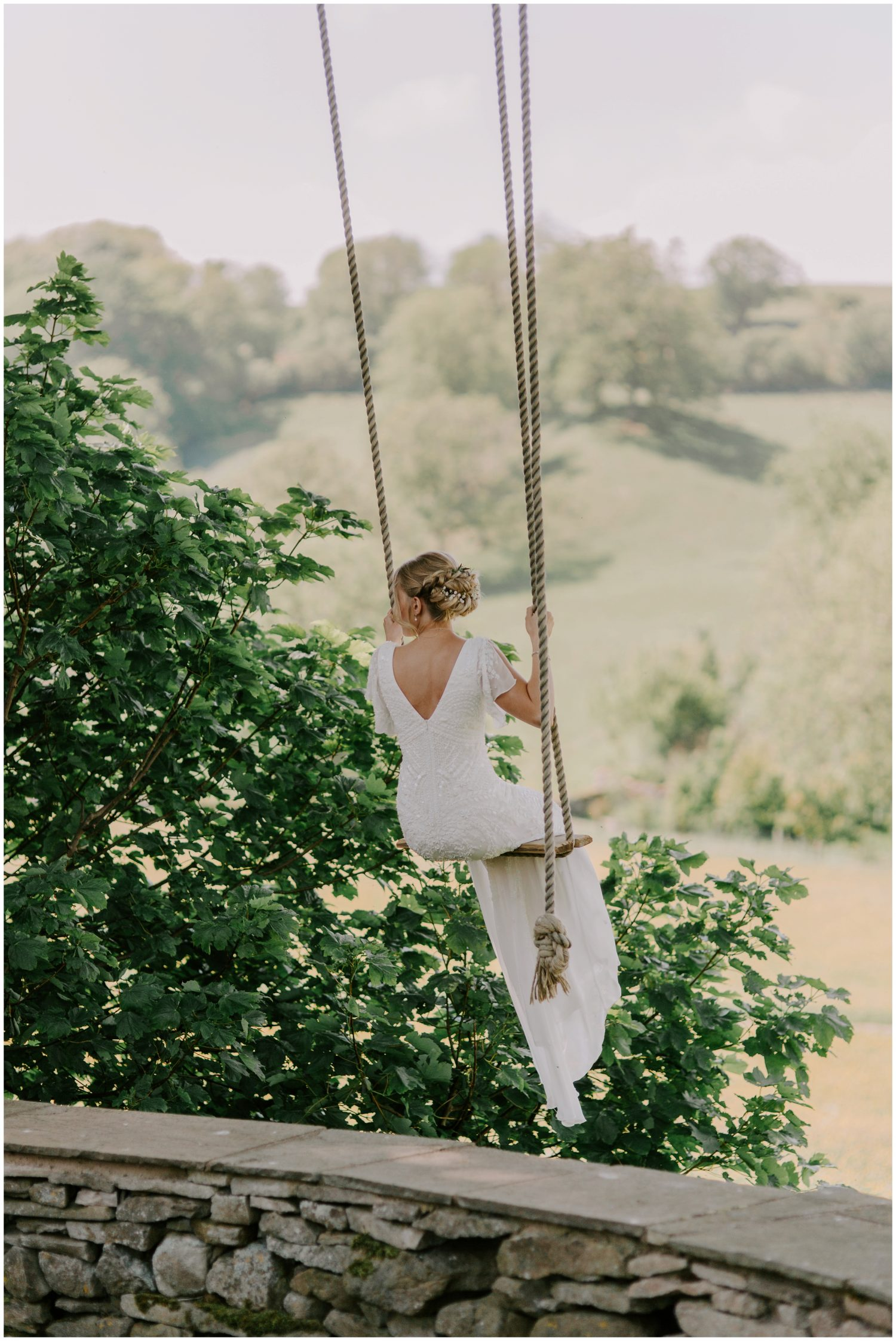 bride swinging in her wedding dress