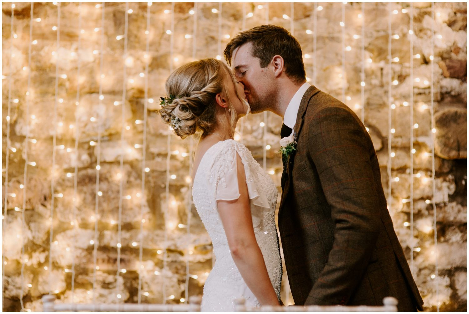 bride and groom share first kiss at eden barn wedding