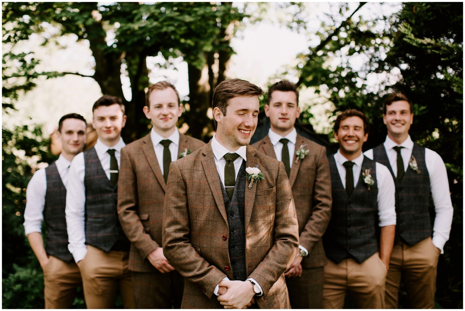 groomsmen in brown tweed suits