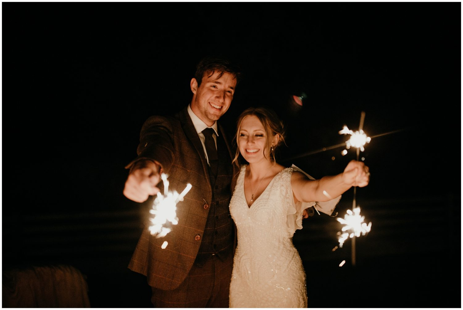 bride and groom with sparklers at wedding