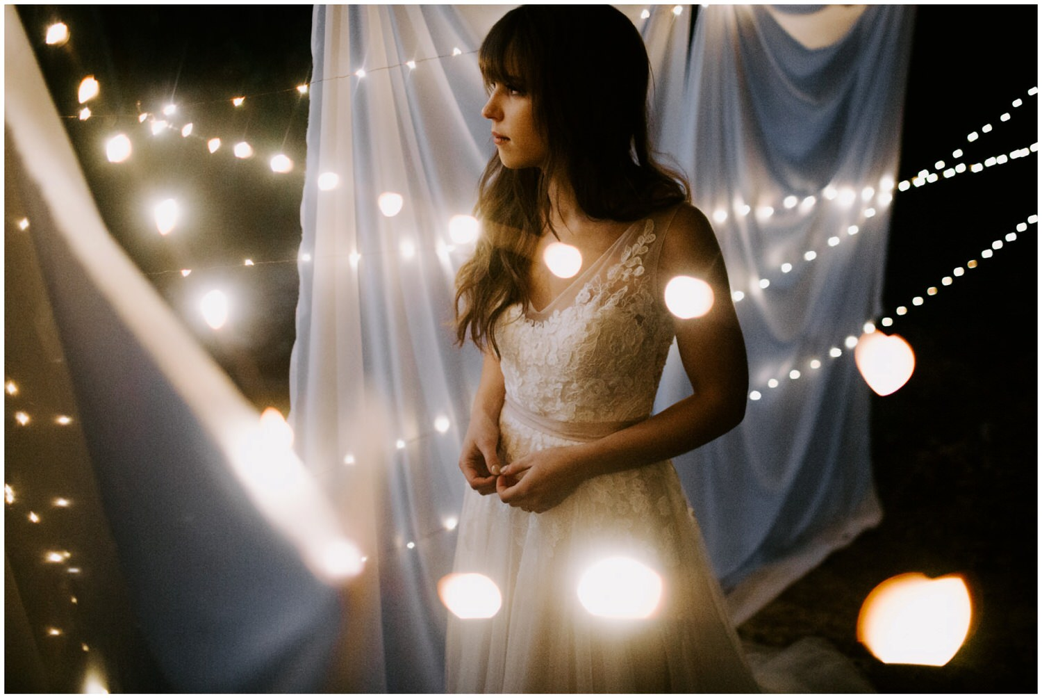 bride in front of twinkle lights