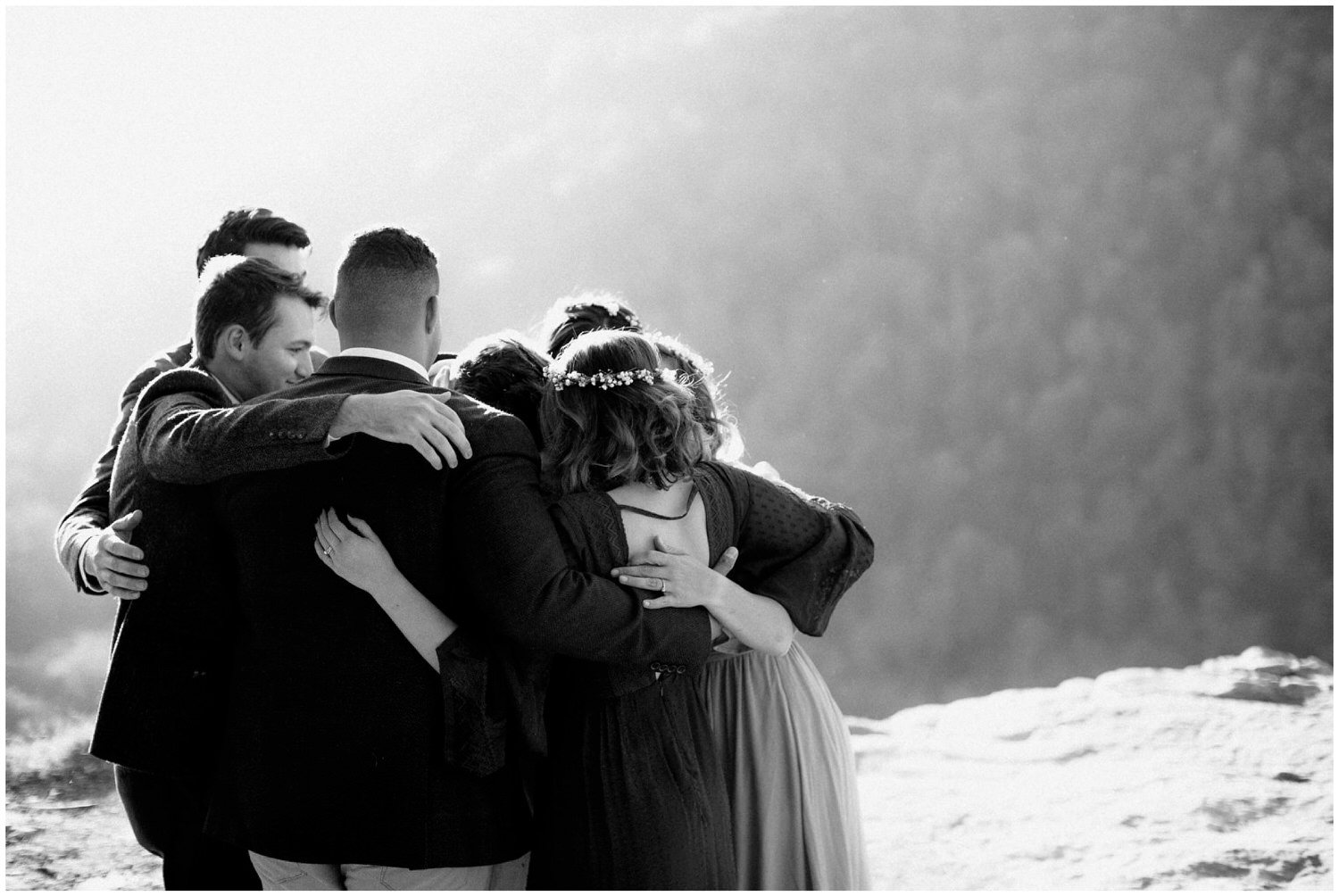 wedding party group hug