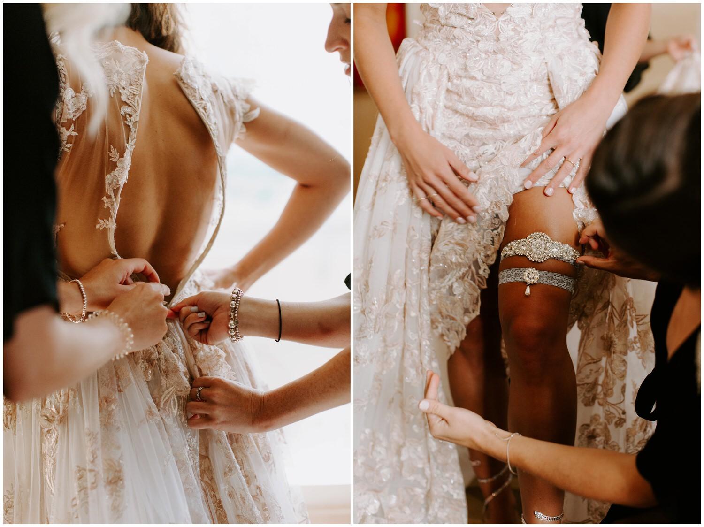 bride putting galia lahav wedding dress on