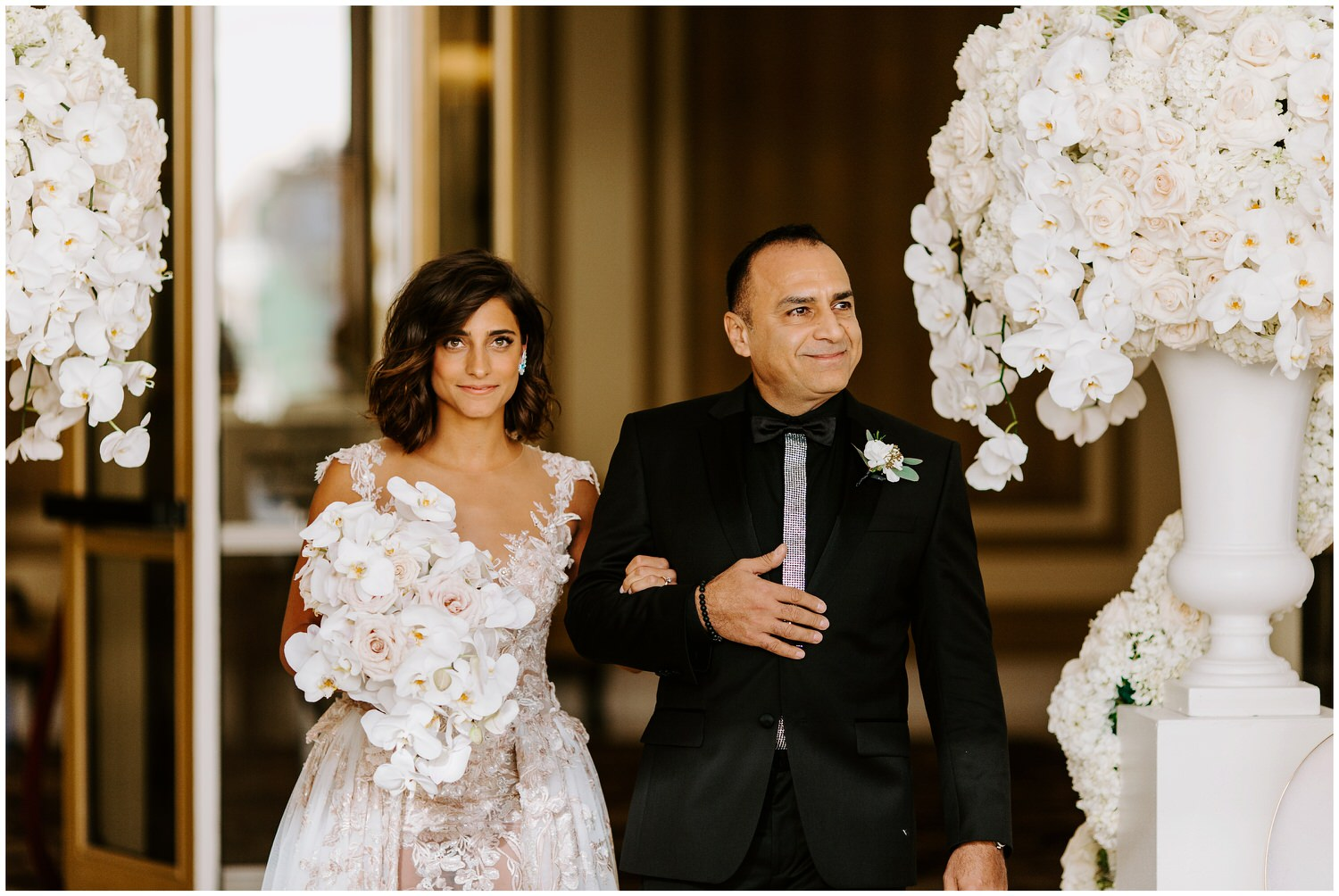 bride wearing galia lahav walking down aisle at bellagio