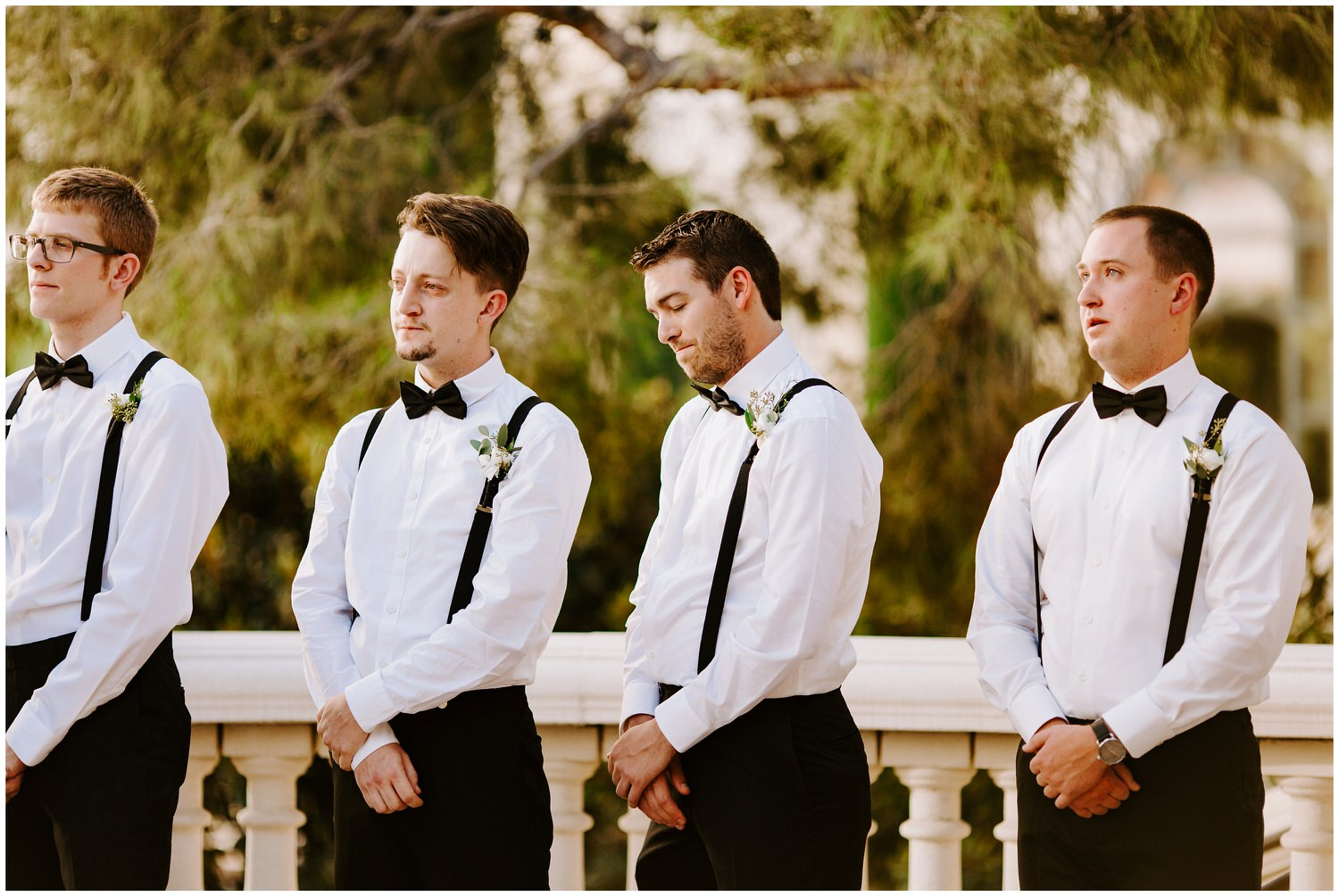 groomsmen crying during wedding ceremony