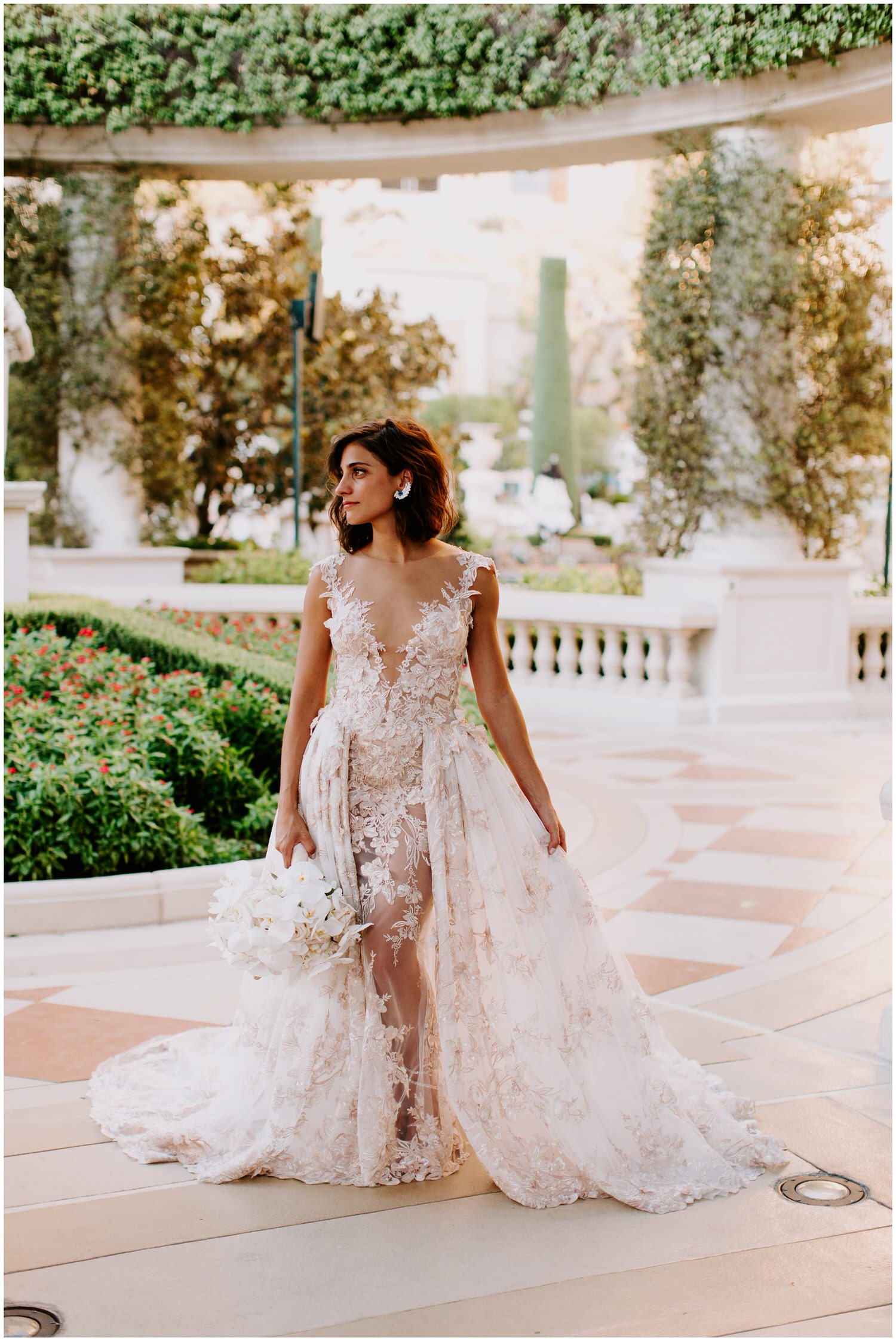 beautiful bride wearing galia lahav wedding gown holding butterfly floral bouquet