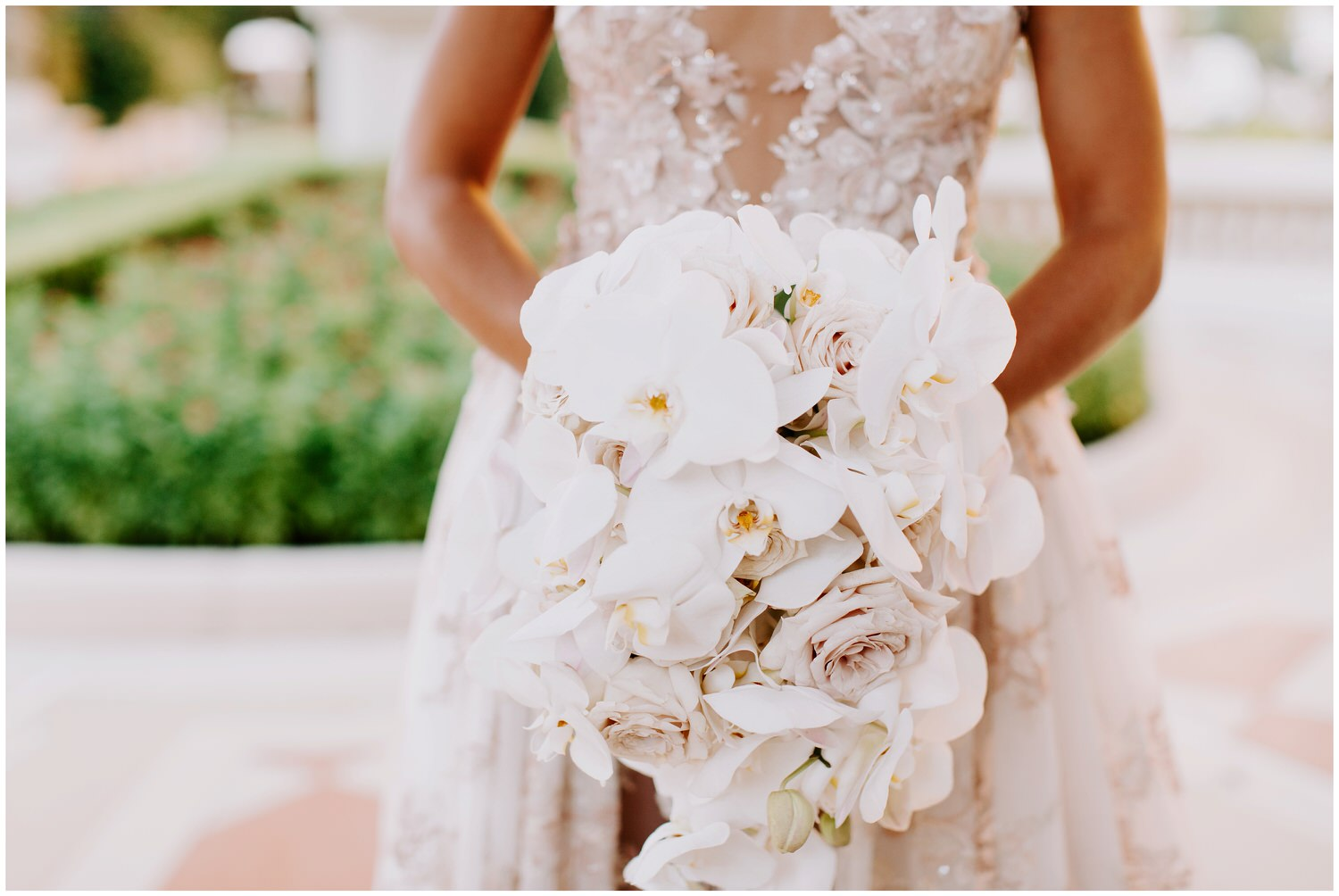 butterfly floral wedding bouquet of iris and roses