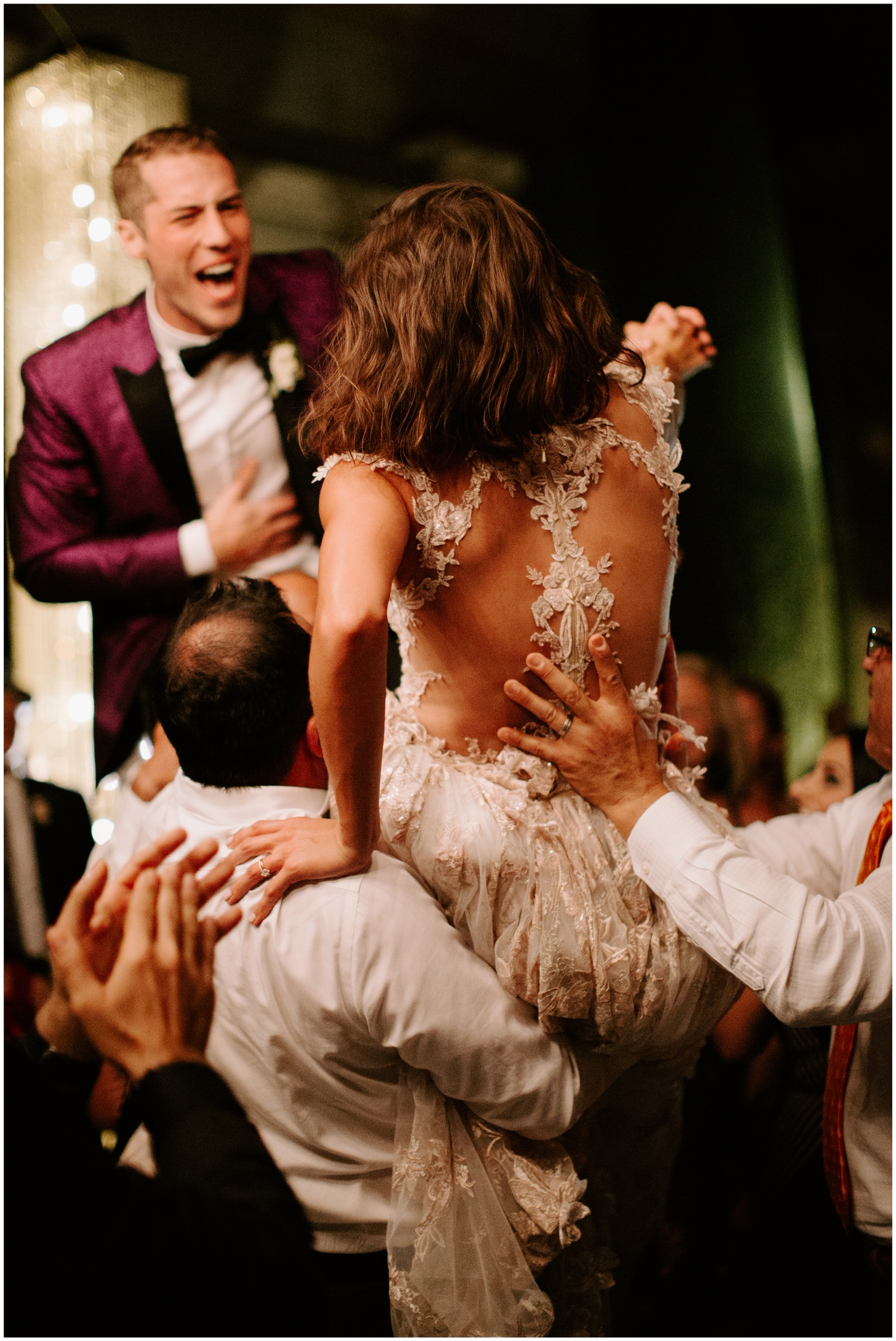 bride and groom crowdsurfing