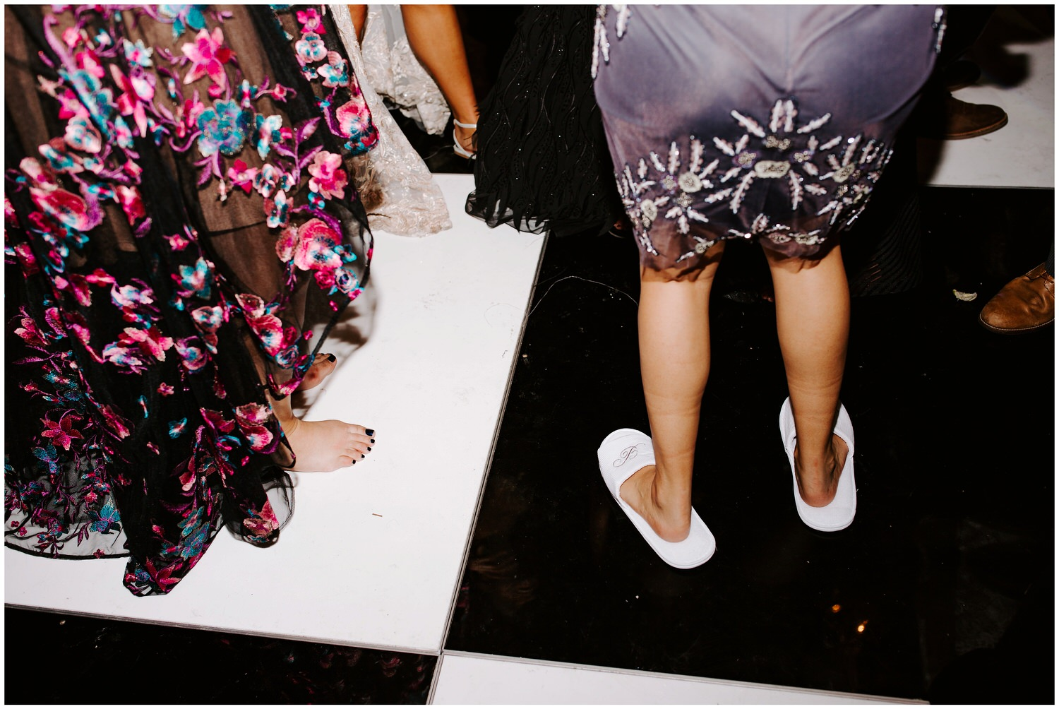 woman wearing slippers at wedding reception