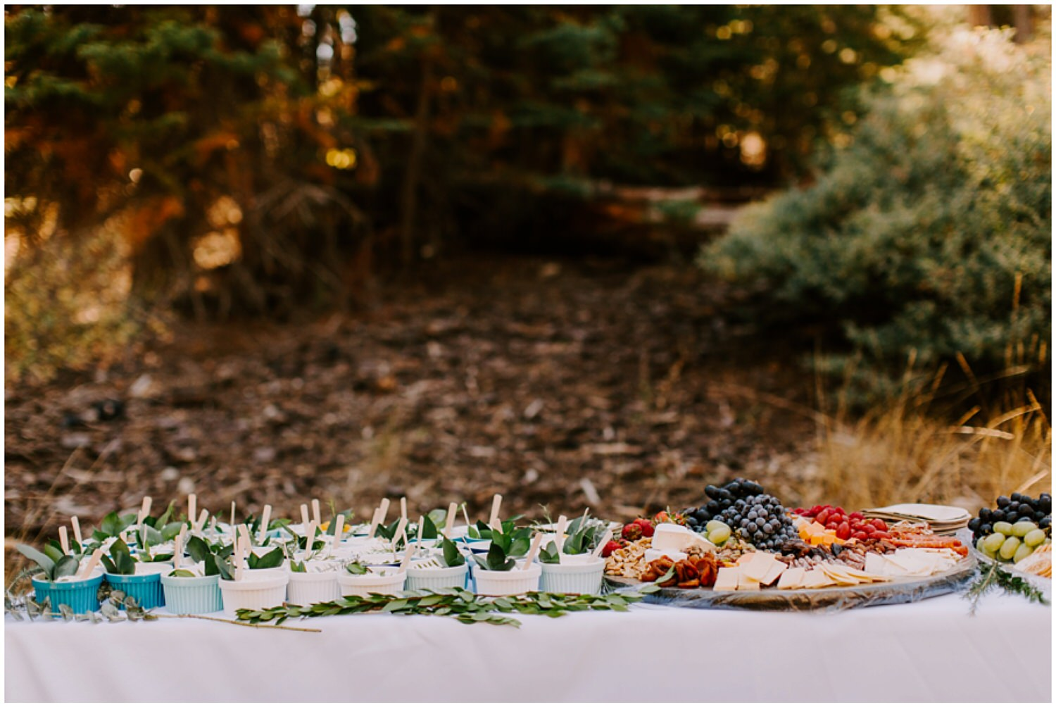 charcuterie board at intimate forest wedding