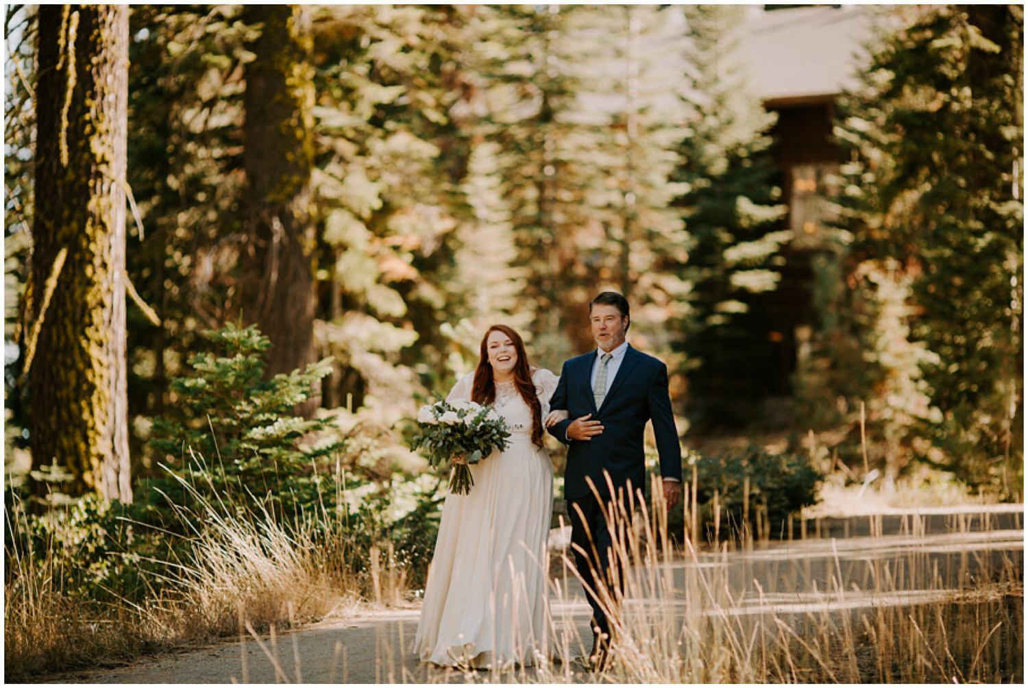 father of bride walking her down the aisle at forest wedding