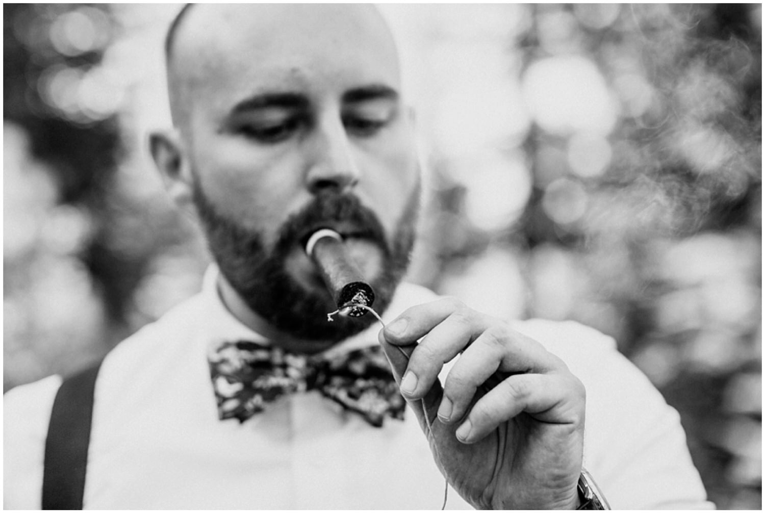 groomsmen lighting a cigar