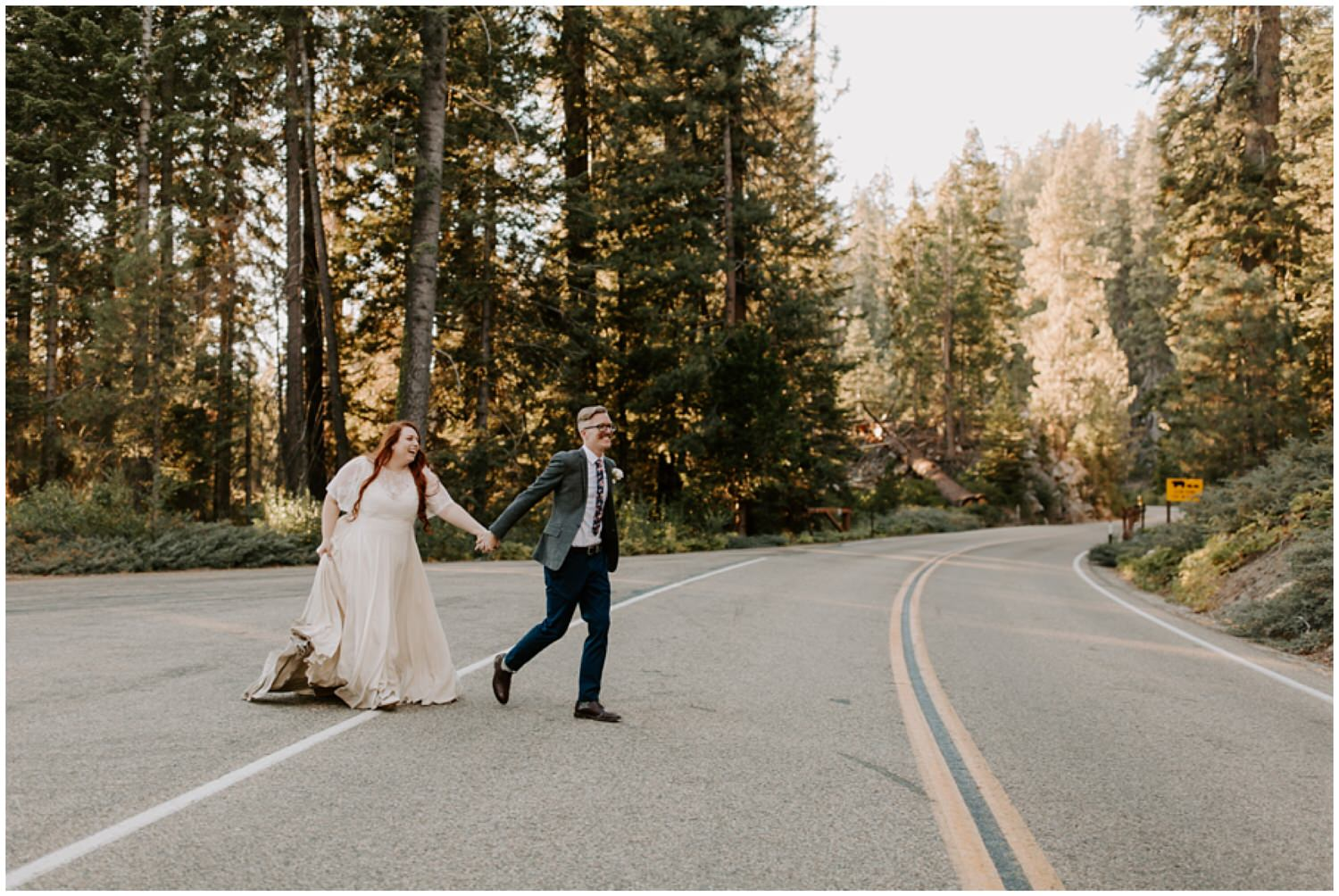 couple running across the road on wedding day
